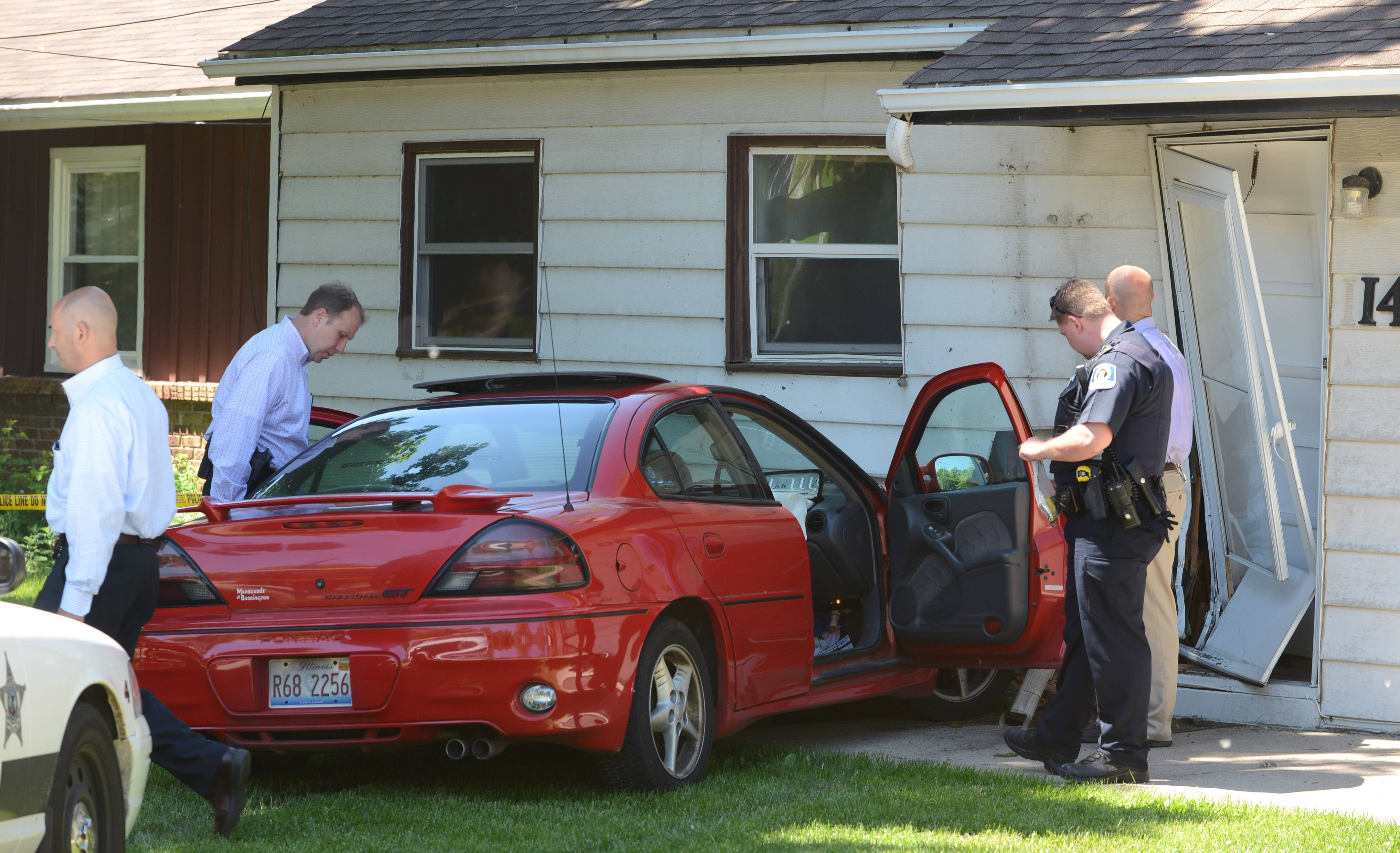 A car crashed into a house on the 1100 block of Diamond Lake Road in Mundelein after a short police chase Tuesday morning.