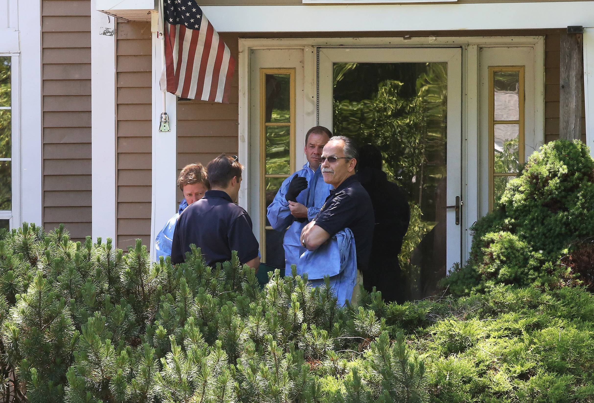 McHenry County sheriff's officials and Island Lake police investigate a death at a house in Island Lake on Tuesday.