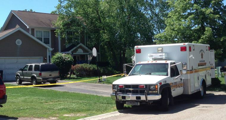 Police investigate a case in Island Lake Tuesday morning.