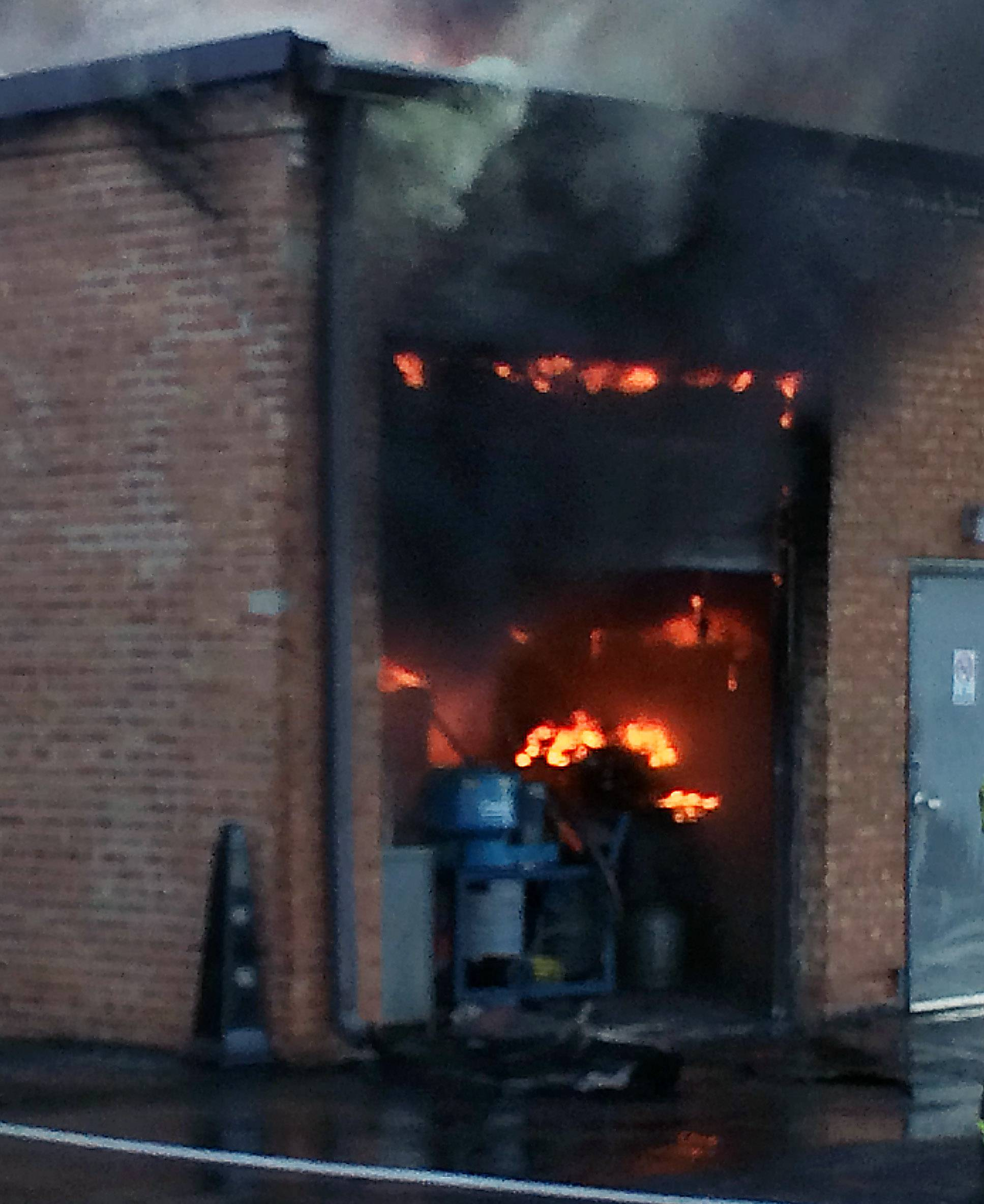 Fire is visible Tuesday morning inside Schaumburg's Taurus Tool and Engineering Inc. on the 500 block of Estes Avenue.