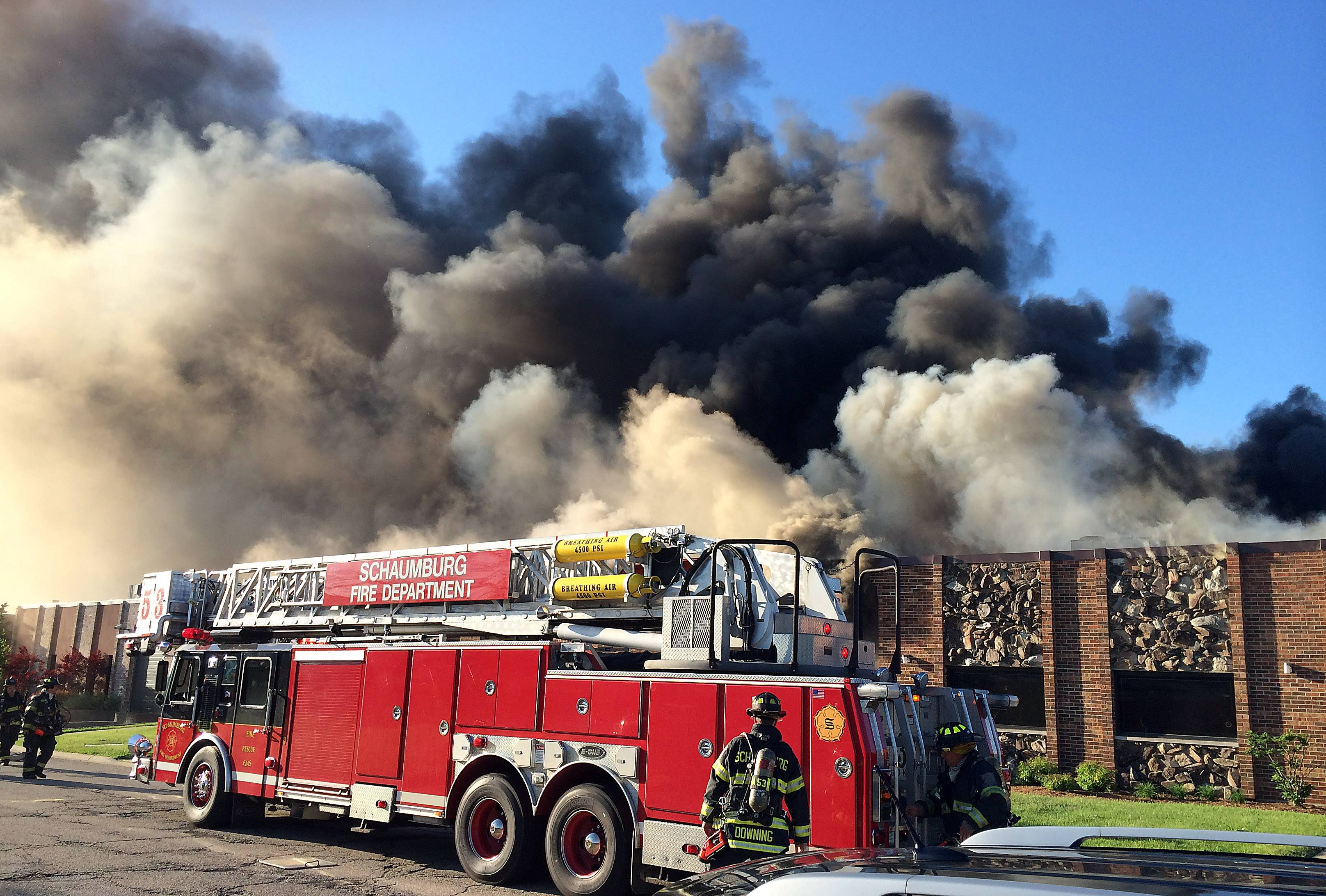 Smoke pours from the roof of Taurus Tool and Engineering Inc. on the 500 block of Estes Avenue in Schaumburg.