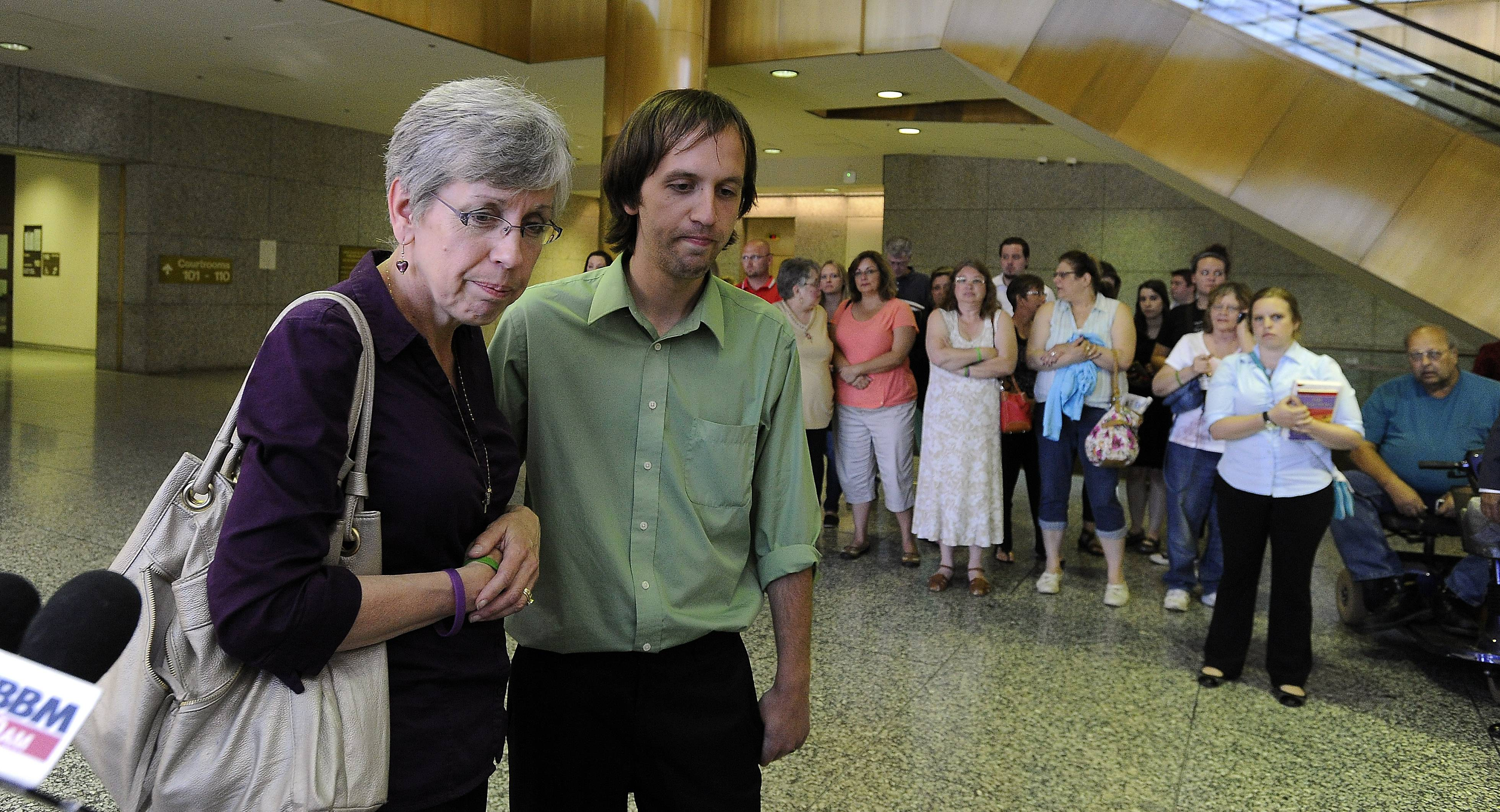 An emotional Jeff Engelhardt and his mother, Shelly Engelhardt, talk to reporters at the Rolling Meadows courthouse after a jury convicted D'Andre Howard of killing three members of the Engelhardt family in their Hoffman Estates home.