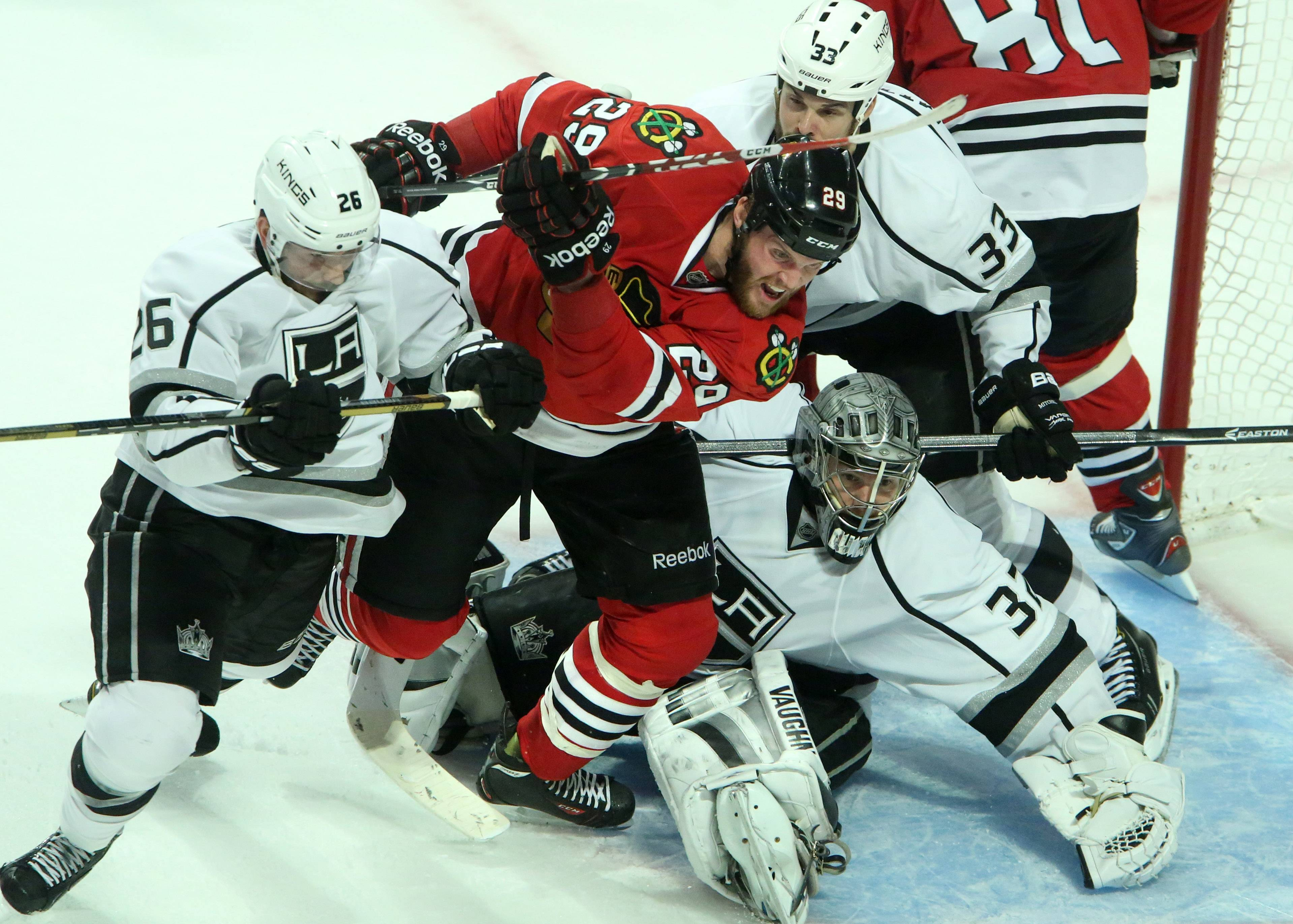 Chicago Blackhawks left wing Bryan Bickell fights for position with Los Angeles Kings defenseman Slava Voynov in front of Los Angeles Kings goalie Jonathan Quick in the third period of Game 7 of the Western Conference finals.
