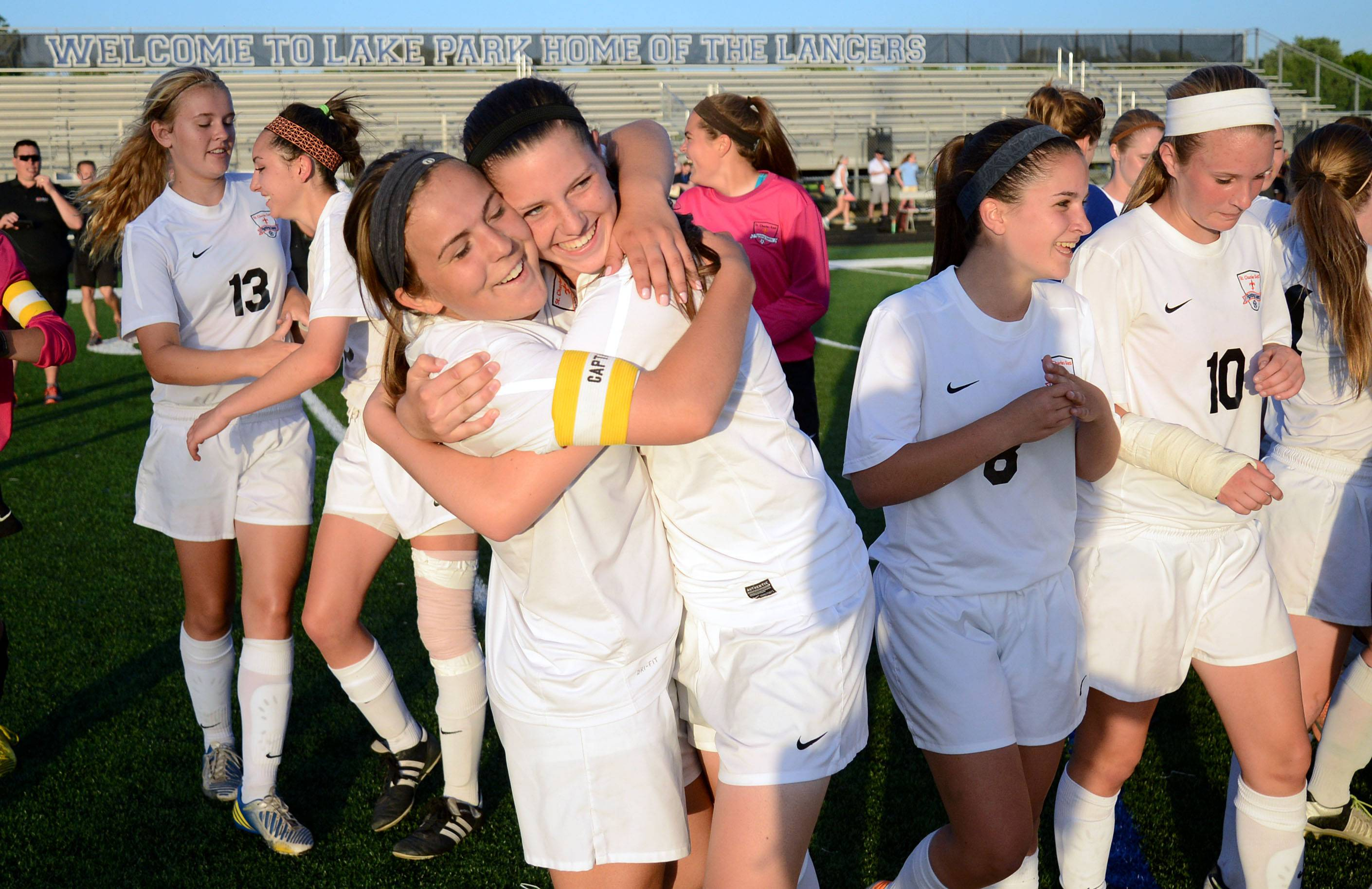 St. Charles East's Anna Corirosi, left, and Rion Gaffney embrace as they walk off the field after their Class 3A girls soccer supersectional win over Huntley at Lake Park High School in Roselle on Tuesday, June 3.