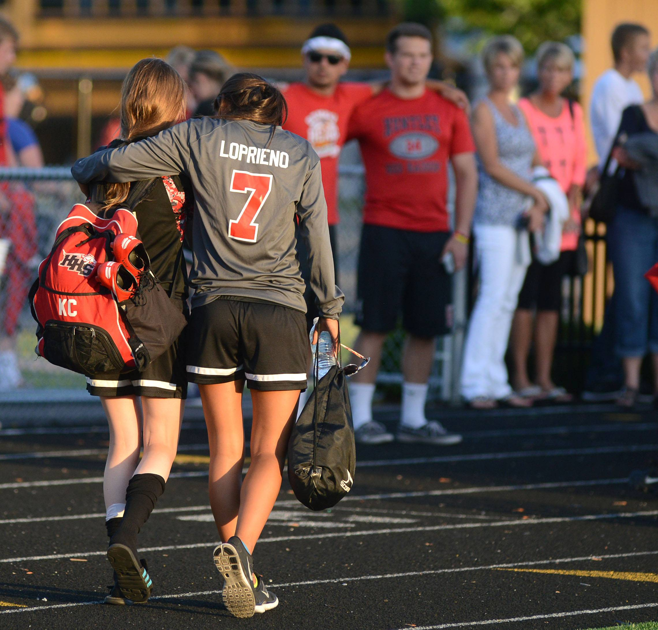 Huntley's Kaitlin Costantino, left, and Delaney Loprieno walk to their fans after their loss to St. Charles East in the Class 3A girls soccer supersectional at Lake Park High School in Roselle on Tuesday, June 3.
