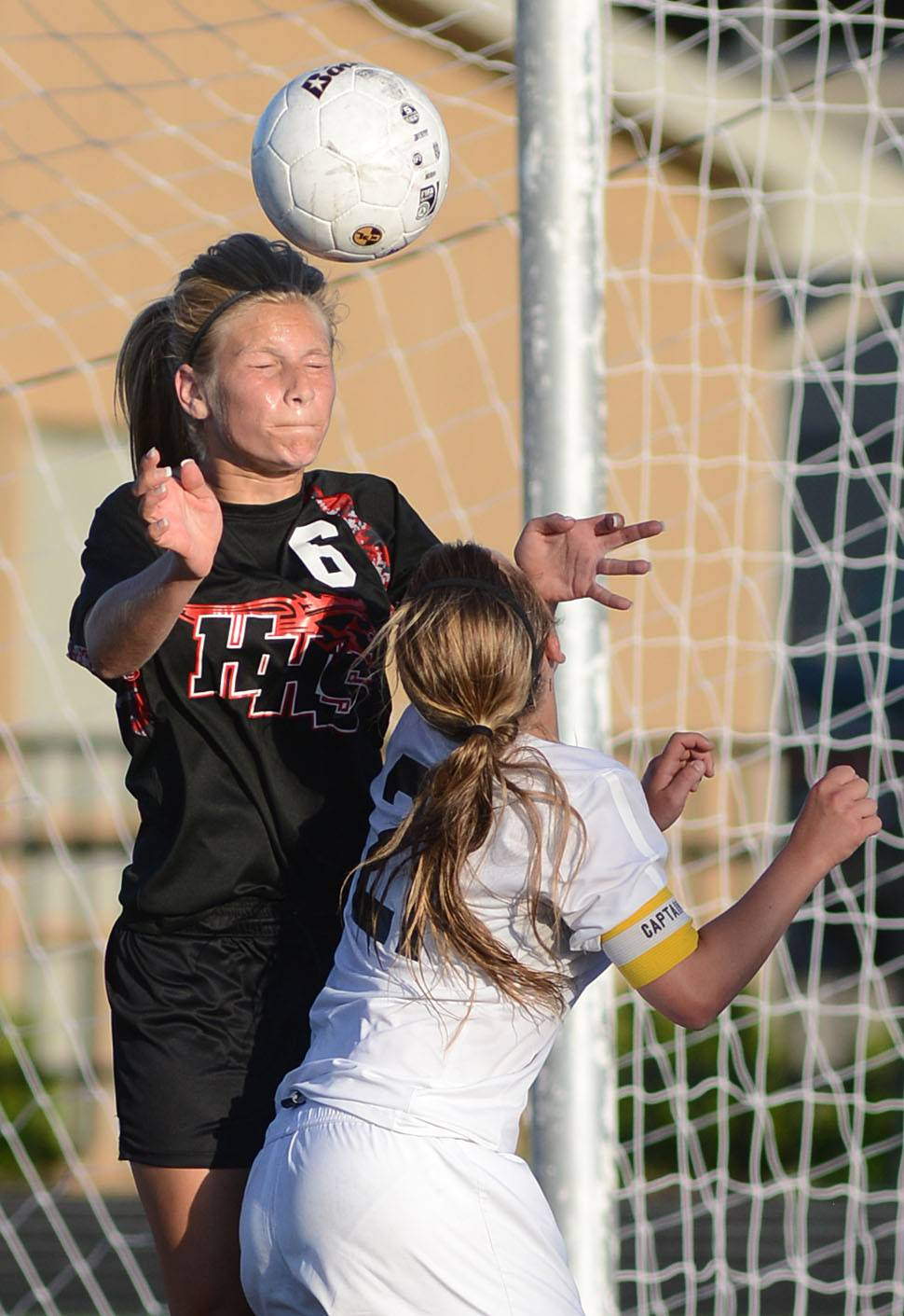 Huntley's Abigail Nordeen heads the ball in front of the net and St. Charles East's Amanda Hilton in the second half of the Class 3A girls soccer supersectional at Lake Park High School in Roselle on Tuesday, June 3.