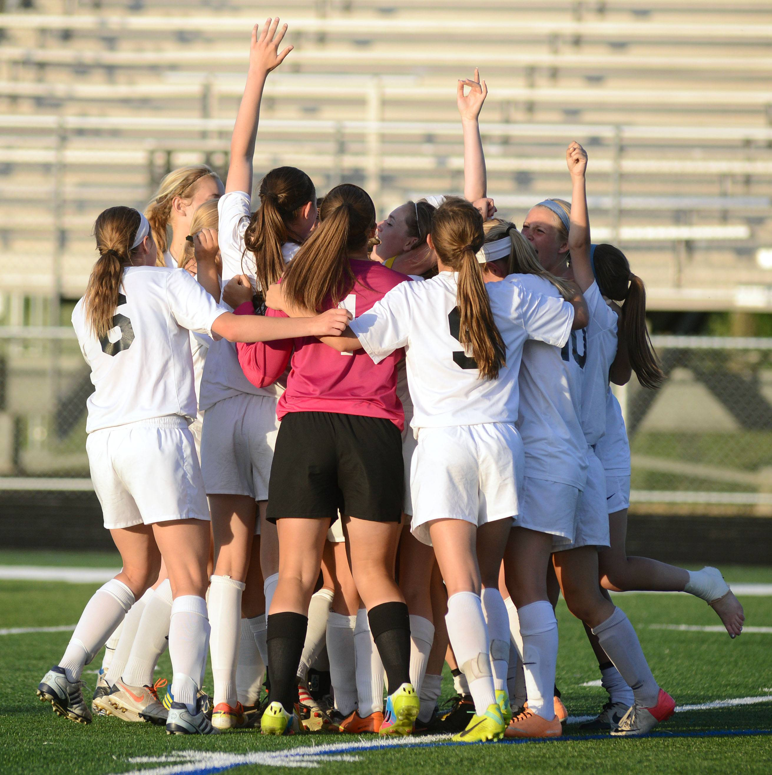 St. Charles East celebrates its win over Huntley on the field in the Class 3A girls soccer supersectional at Lake Park High School in Roselle on Tuesday, June 3.