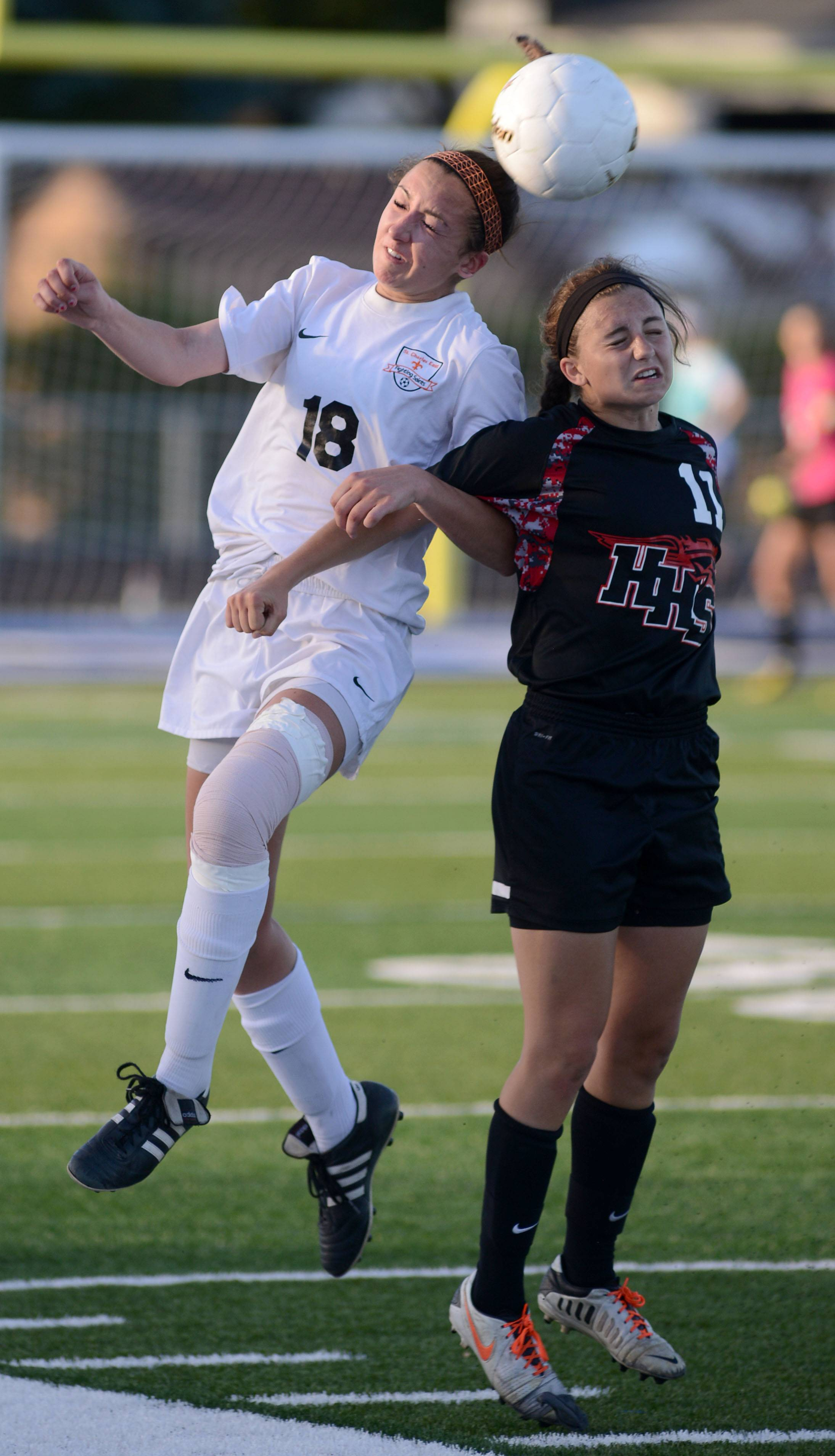 St. Charles East's Mallory Mollenhauer and Huntley's Taryn Jakubowski fight for the ball in the second half of the Class 3A girls soccer supersectional at Lake Park High School in Roselle on Tuesday, June 3.