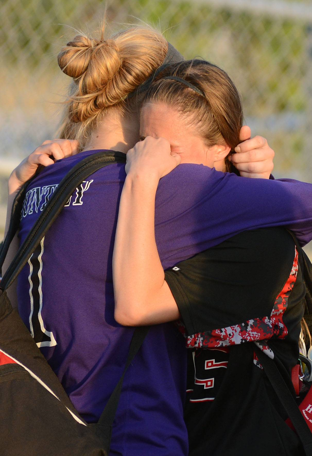 Huntley's Jessica Galason, left, comforts teammate Kaitlin Costantino after their loss to St. Charles East in the Class 3A girls soccer supersectional at Lake Park High School in Roselle on Tuesday, June 3.