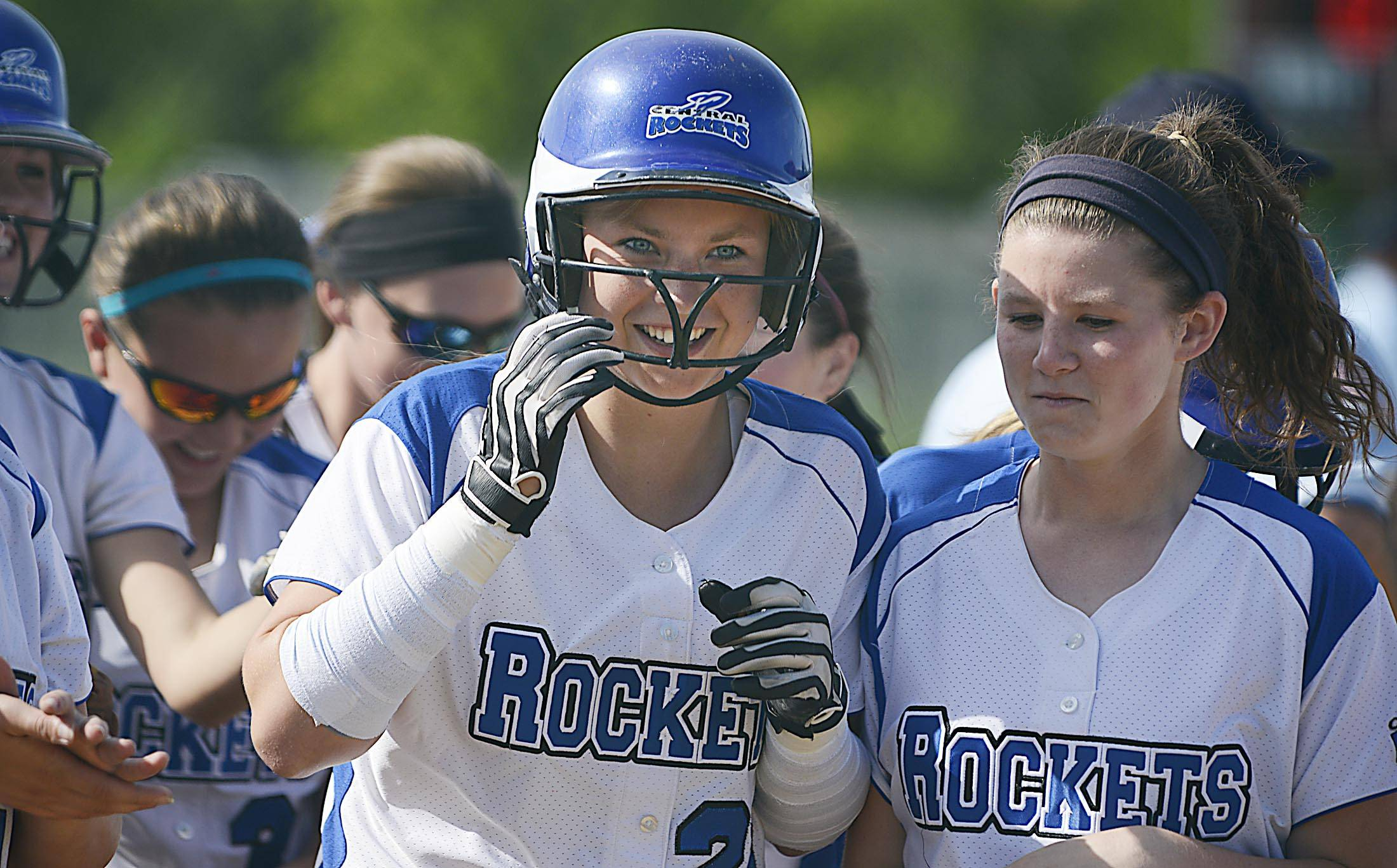 Burlington Central's Kassidy Gaylord laughs after her first inning home run against Sterling Tuesday in the Class 3A Marengo sectional semifinal game.