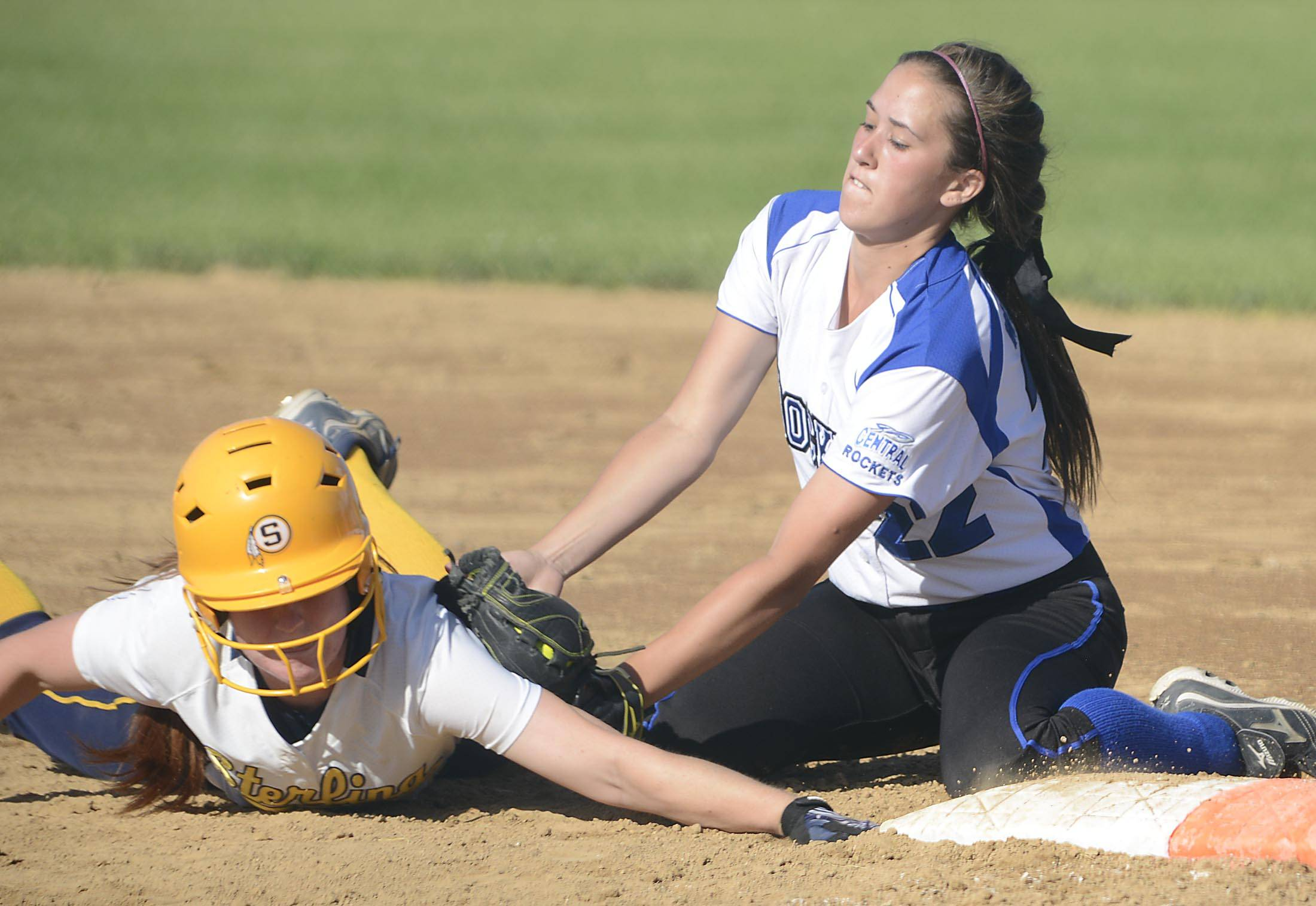 Burlington Central's Kelly Wiater tags Sterling's Darien Bardoner out at first base in the fourth inning Tuesday in the Class 3A Marengo sectional semifinal game.