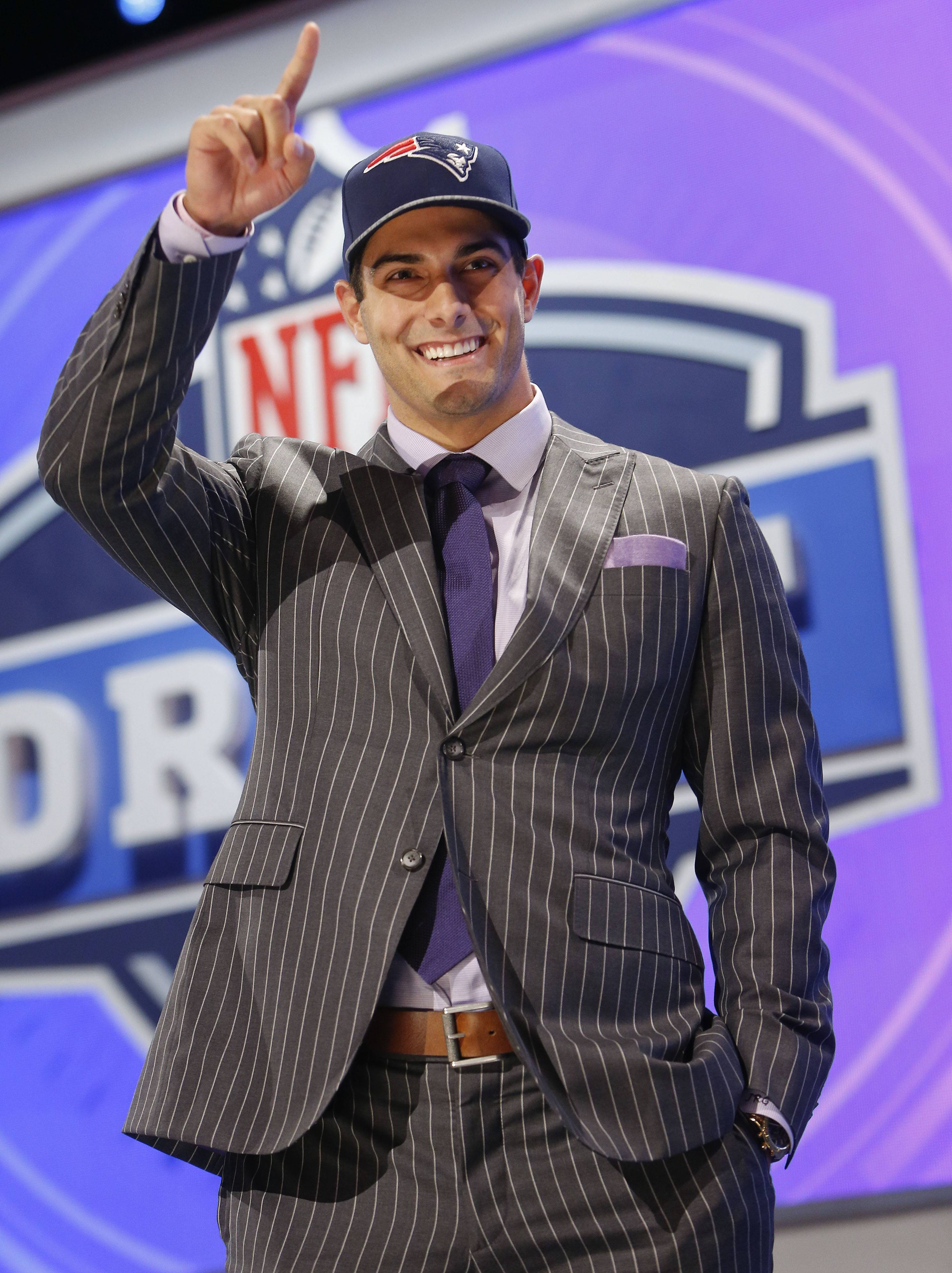 Eastern Illinois quarterback Jimmy Garoppolo reacts after being selected as the 62nd pick by the New England Patriots in the second round of the 2014 NFL Draft in New York.