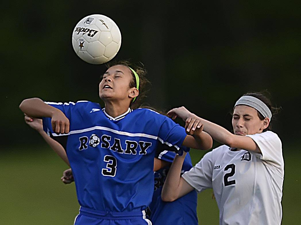 Rosary's Gabriella Wagoner gets to a header before Dekalb's Kayley Garland Tuesday in the Hampshire sectional.