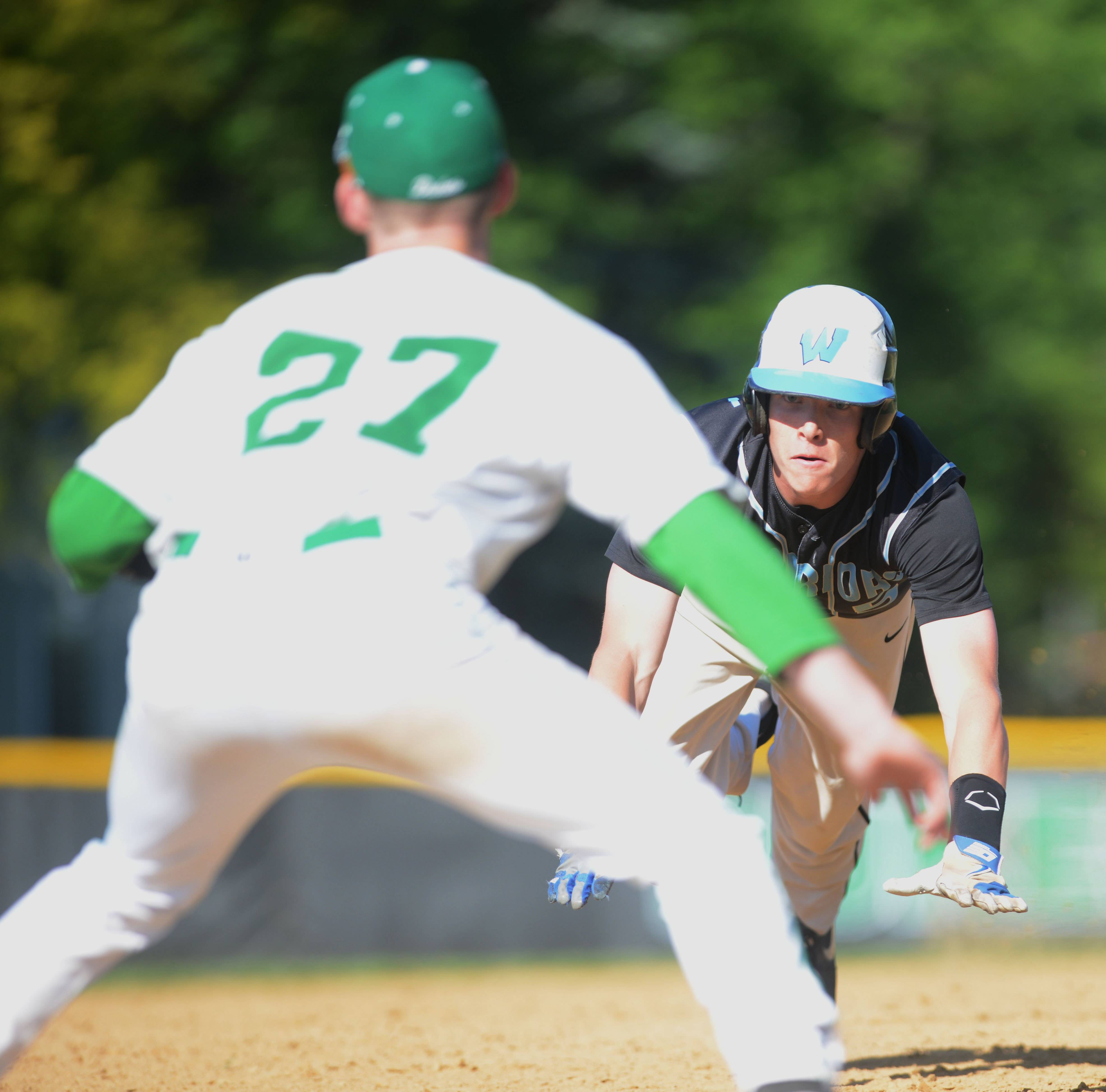 Mike Homan of York  gets ready for Brian Johnson of Willowbrook as he slides into third base .
