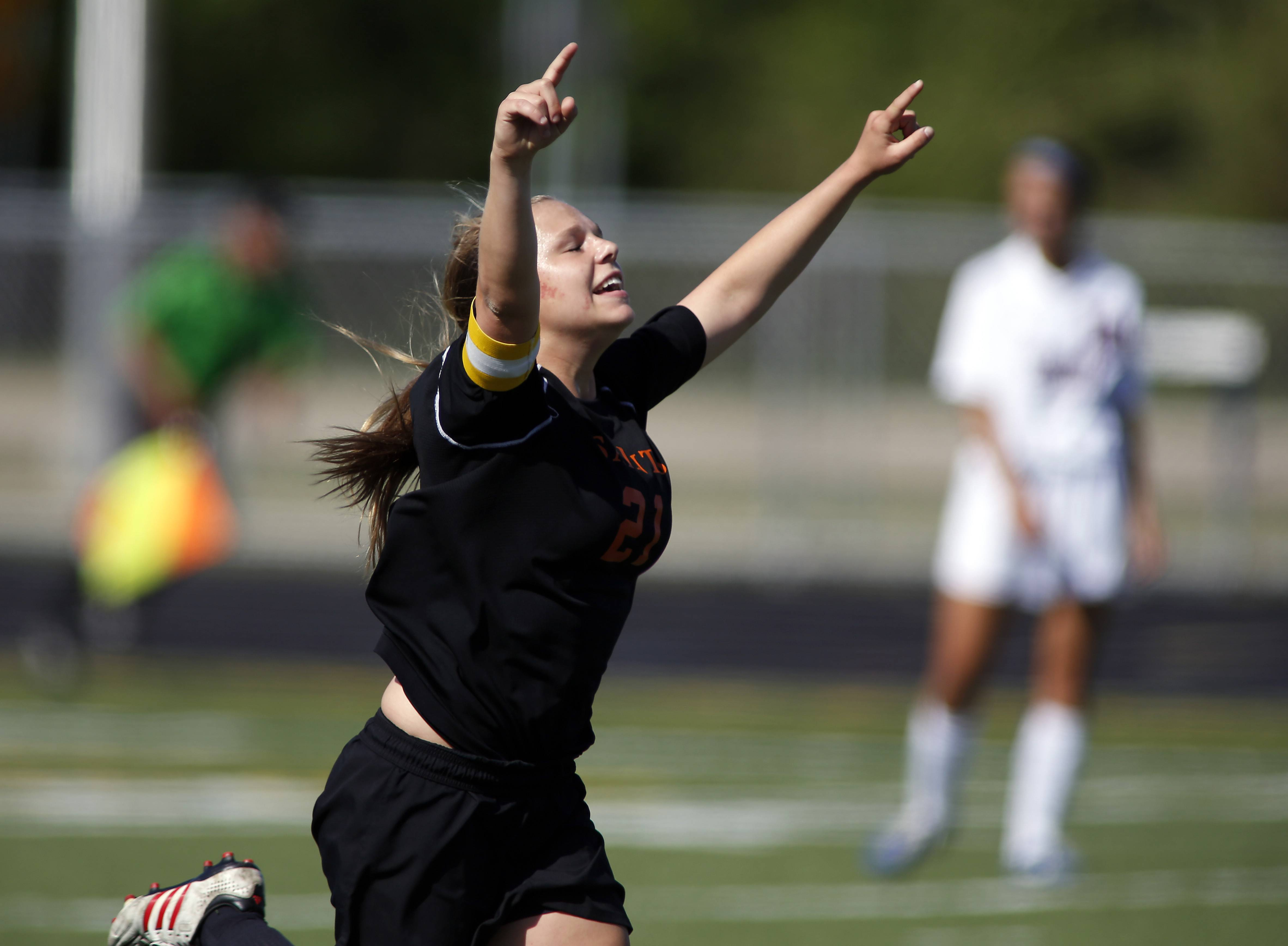 St Charles East's Amanda Hilton celebrates after her first half goal during St. Charles East vs. Conant girls soccer sectional title game Friday.