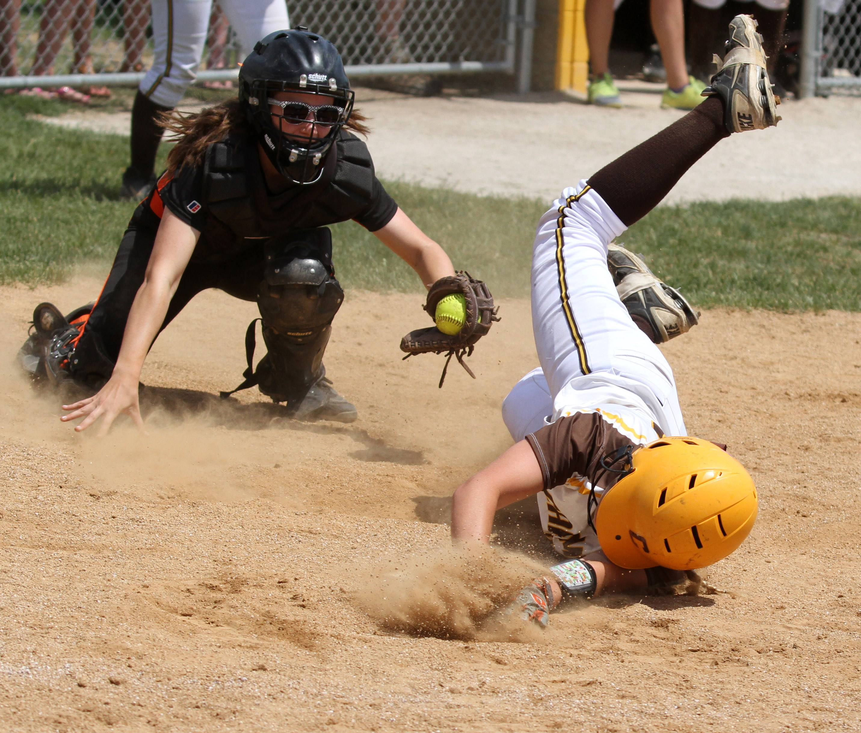Libertyville catcher Andi Katz is able to tag Carmel's Amy Abel out at home plate.