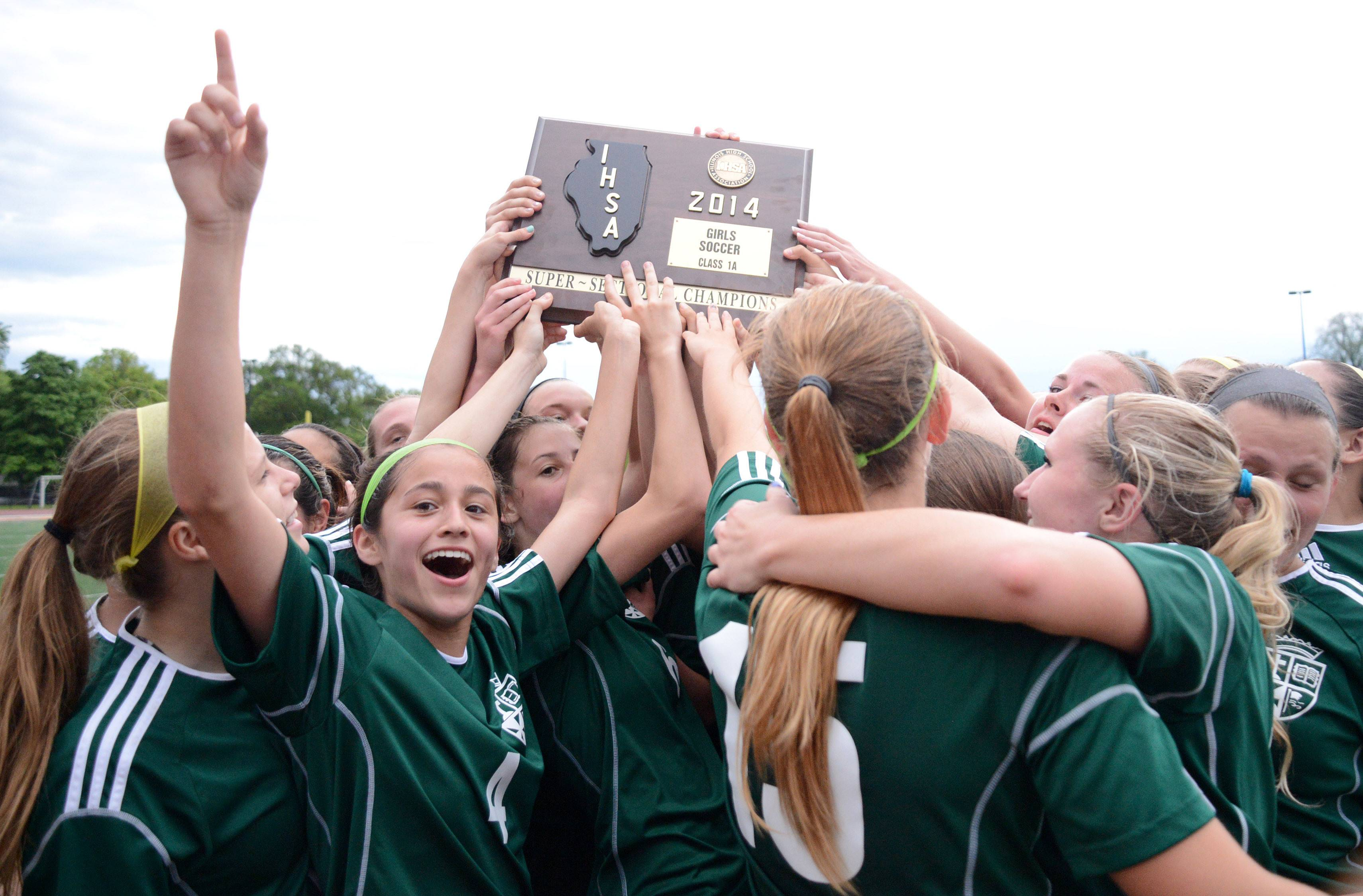 St. Edward's Monica Ramirez, facing, celebrates with teammates after their Class 1A supersectional win over Chicago Latin at Concordia University in River Forest on Tuesday, May 27.