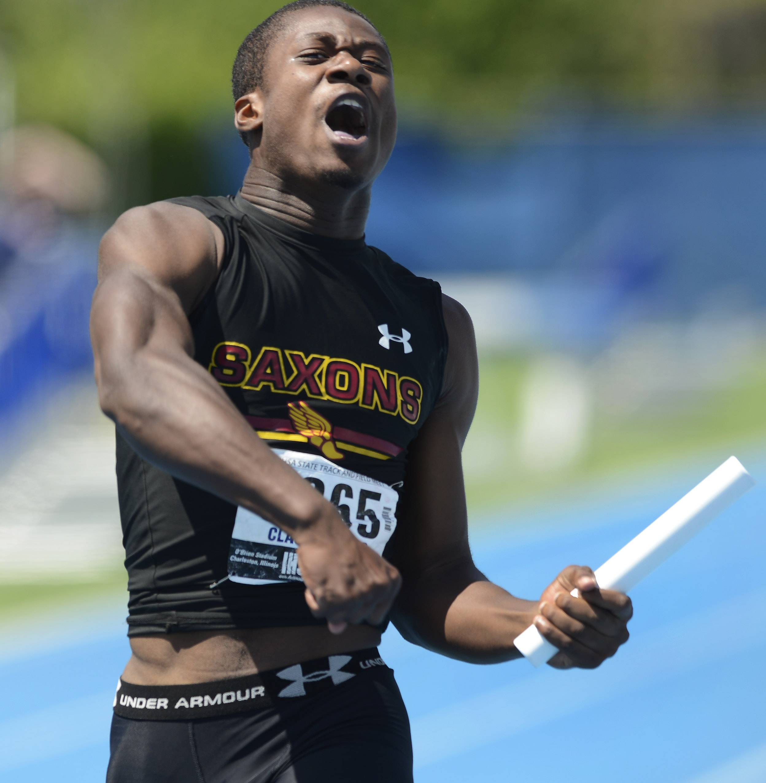 Schaumburg's Jarman McMillon celebrates at the finish line as his team anchors the 4x200-meter relay during the boys class 3A state track and field finals in Charleston Saturday.