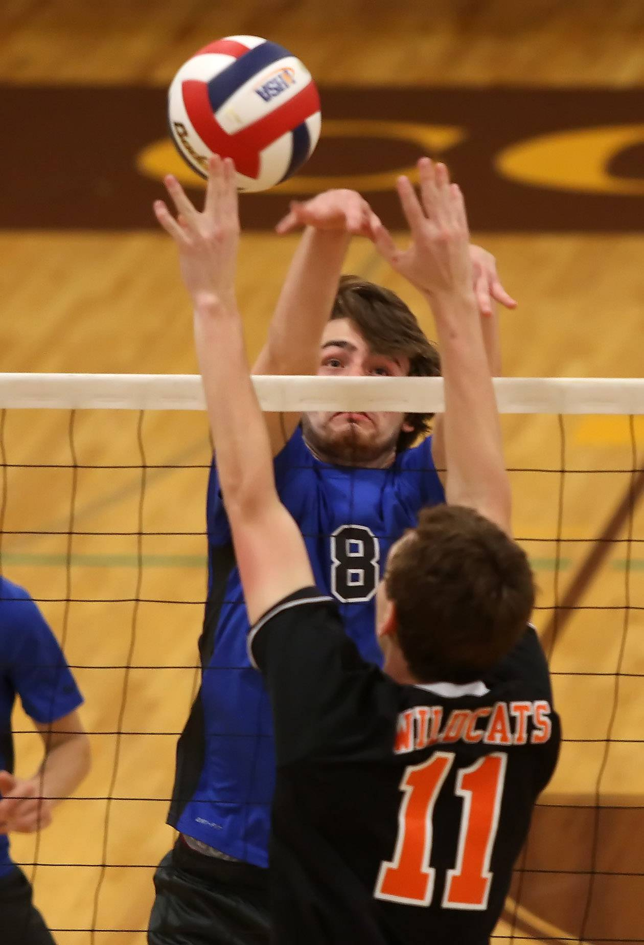 Vernon Hills player Ryan Opitz battles for the ball against Libertyville player Zach Hauser during the boys volleyball game Tuesday between Libertyville and Vernon Hills at Carmel High School in Mundelein.