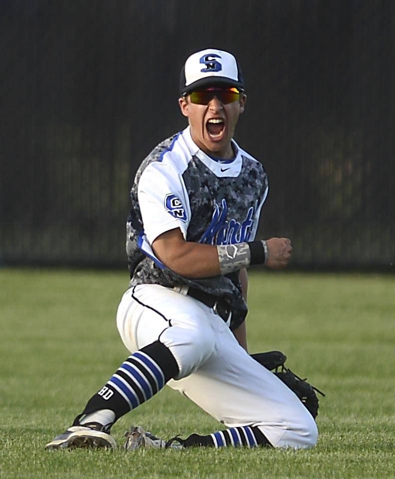 St. Charles North's Anthony Lambert reacts after catching the last out in left field against Glenbard East in the regional semifinal game in St. Charles.