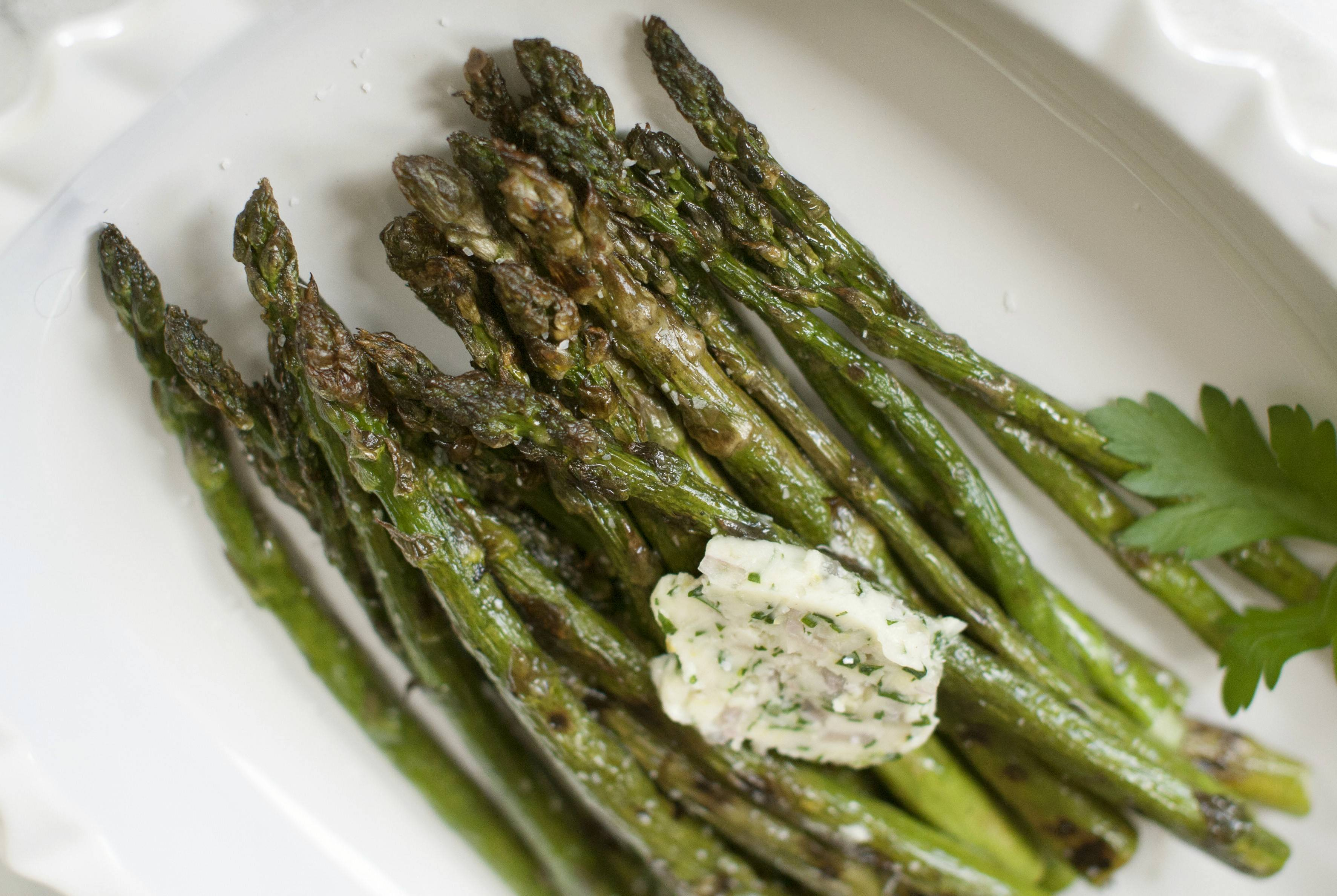 Lemony butter makes grilled asparagus simply addictive.