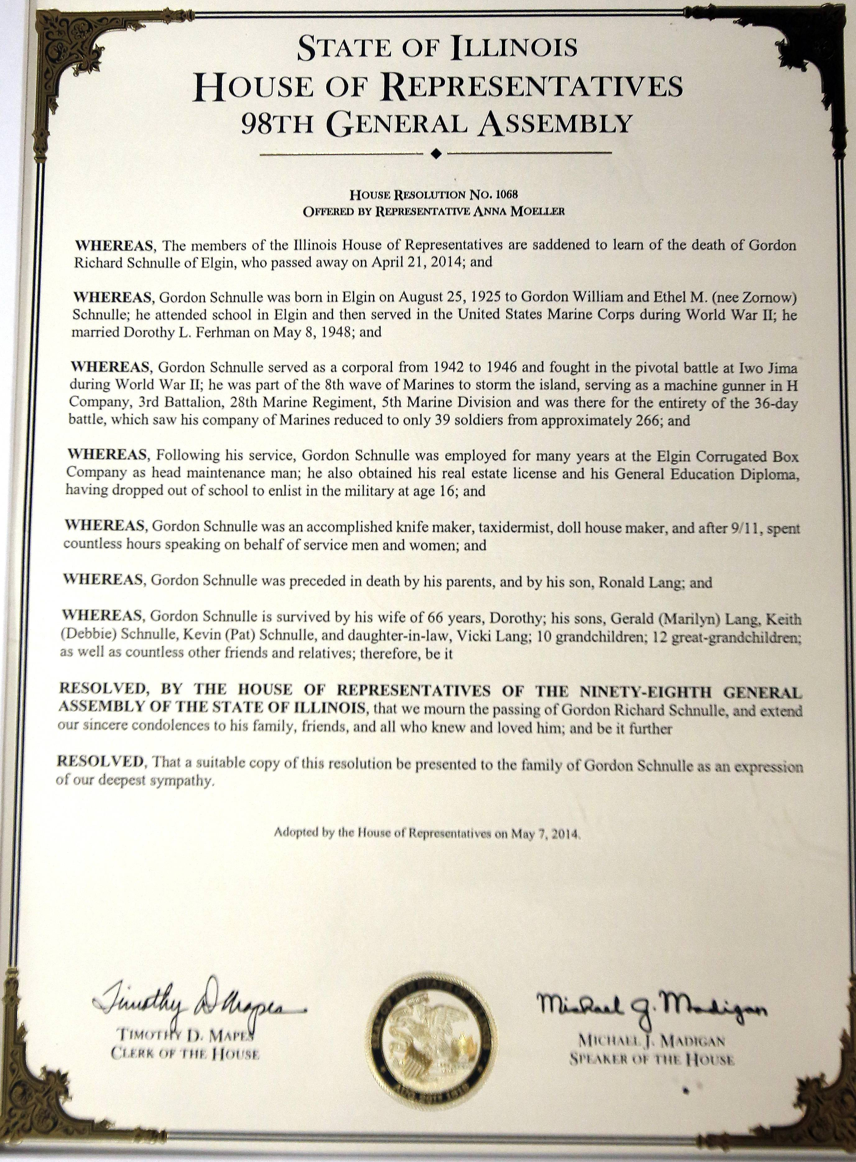 State Rep. Anna Moeller and State Sen. Michael Noland Wednesday presented Gordon Schnulle's widow, Dorothy, with this joint resolution from both Illinois Houses honoring Schnulle's life.