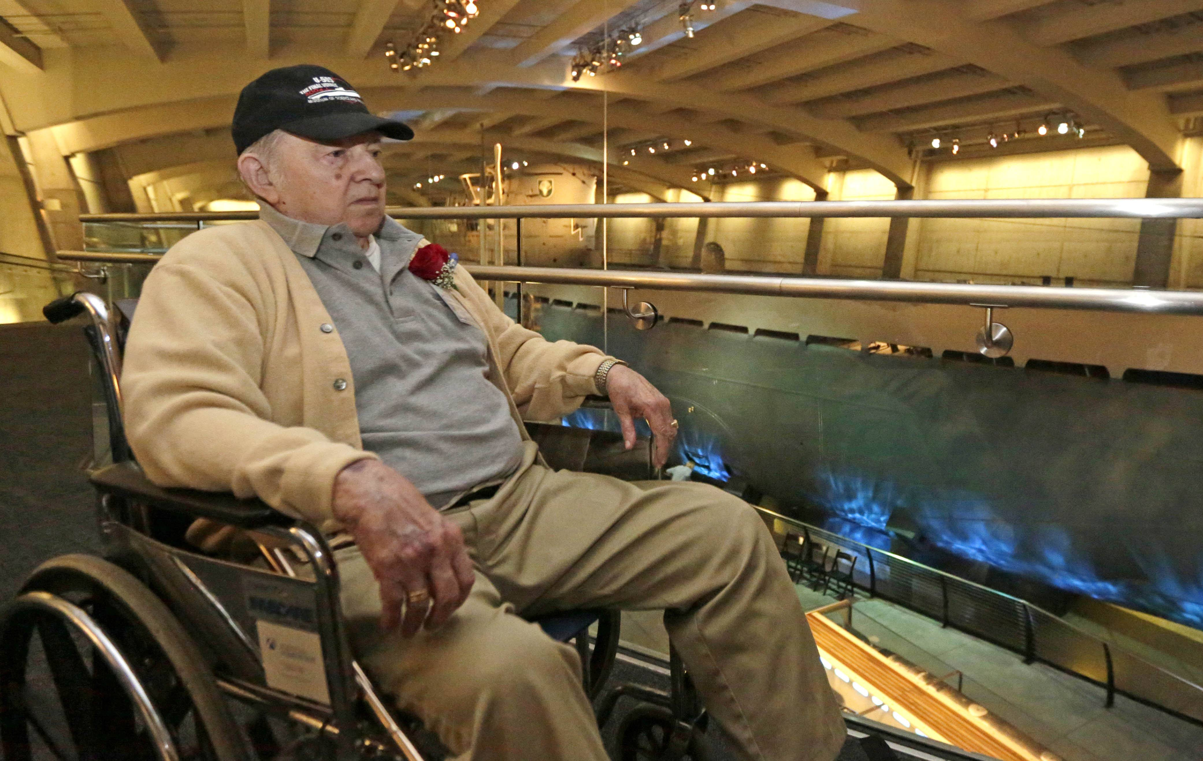 World War II veteran Gordon Höhne of Massachusetts looks down at the captured U-505 German submarine on display at the Museum of Science and Industry in Chicago. It is the only German submarine the U.S. Navy captured during the war and one of five left in the world.