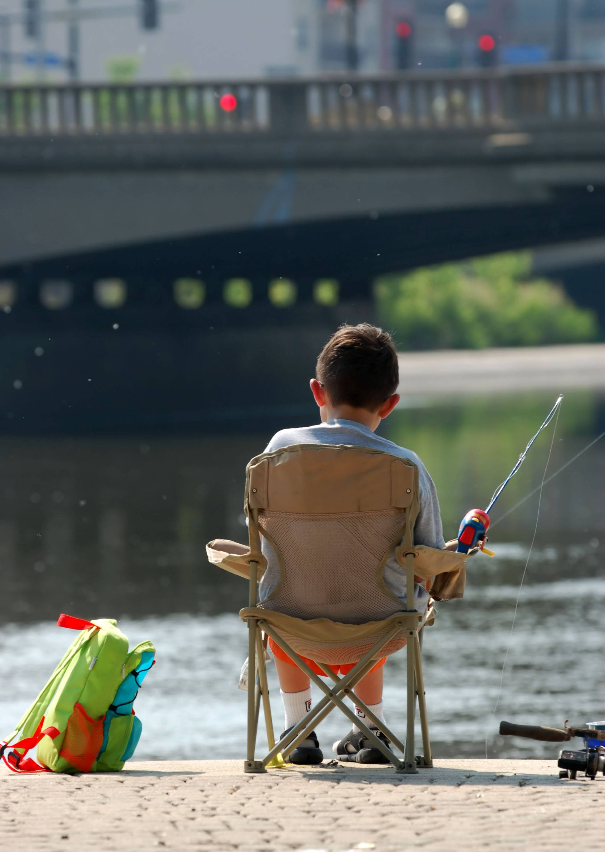 Michael Garand, 9, of Elgin, sits patiently while waiting for a fish at a previous Fish for Fun derby in Elgin.