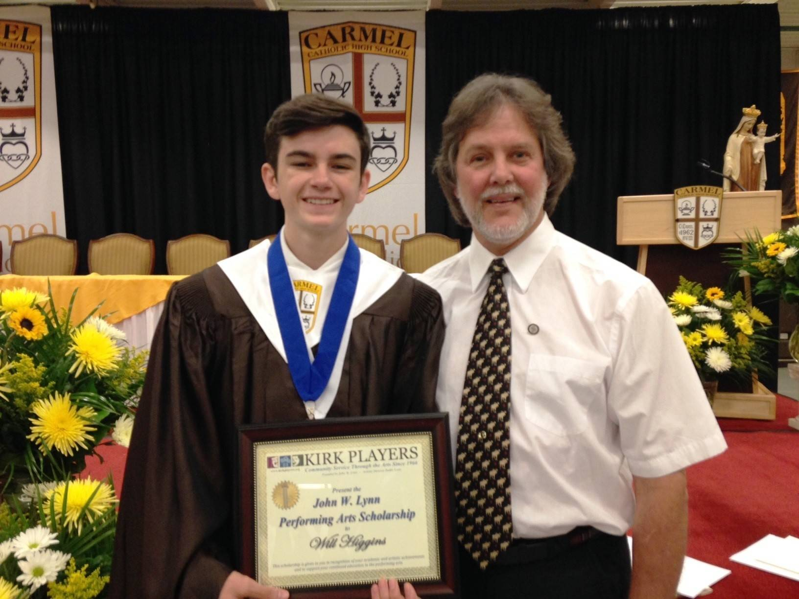 William Higgins of Carmel Catholic High School in Mundelein was awarded the Kirk Players' John W. Lynn Performing Arts Scholarship.