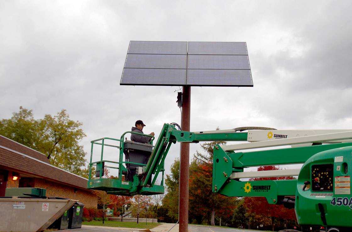 A worker installs a solar panel at Butterfield School in Libertyville in 2009. Two schools, including Butterfield, in Libertyville Elementary District 70 are going to get hundreds of individual solar panels installed on their roofs. The panels are expected to produce about a third of each building's energy.