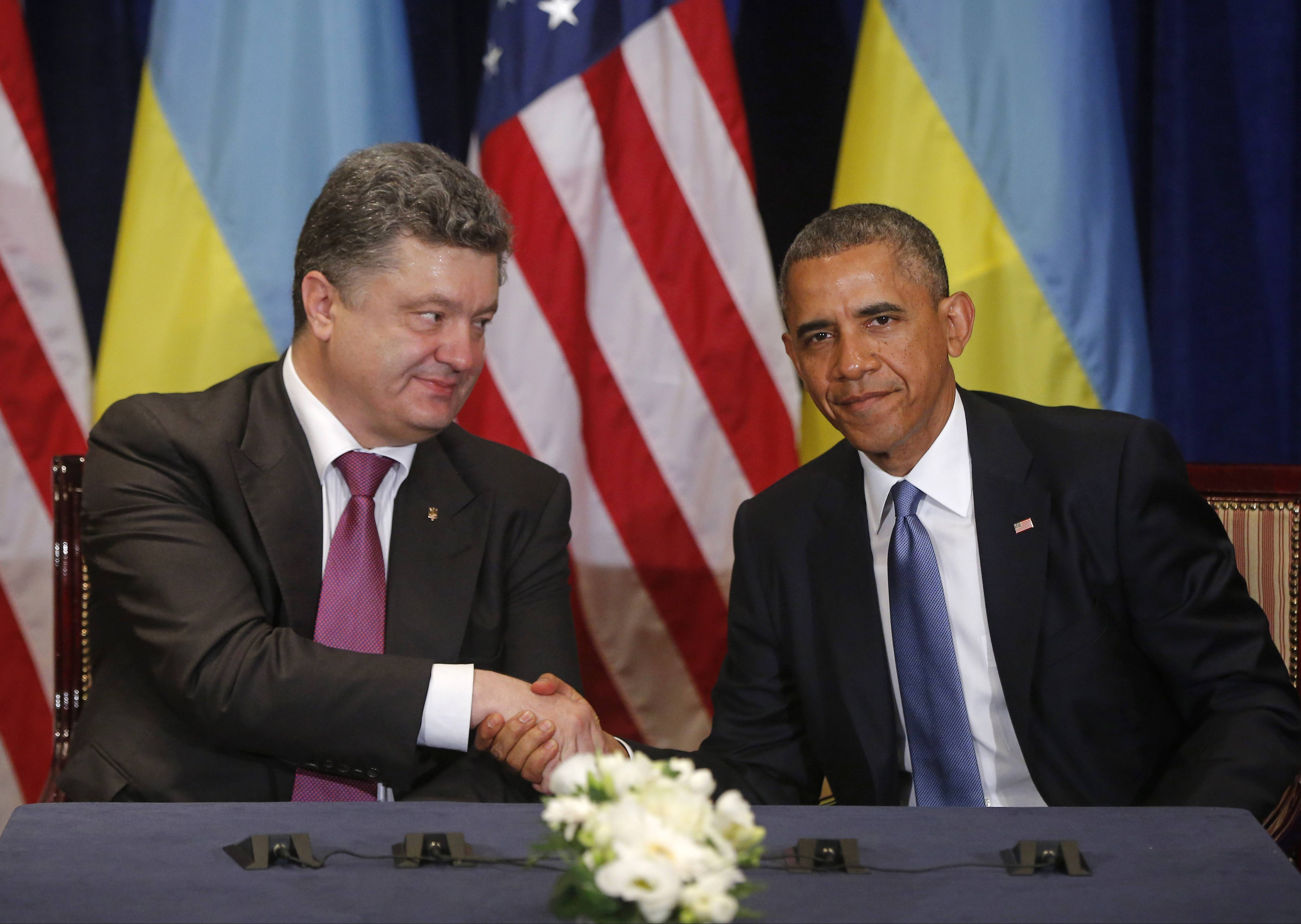 President Barack Obama, right, shakes hands with Ukraine president-elect Petro Poroshenko in Warsaw, Poland, Wednesday, June 4, 2014.