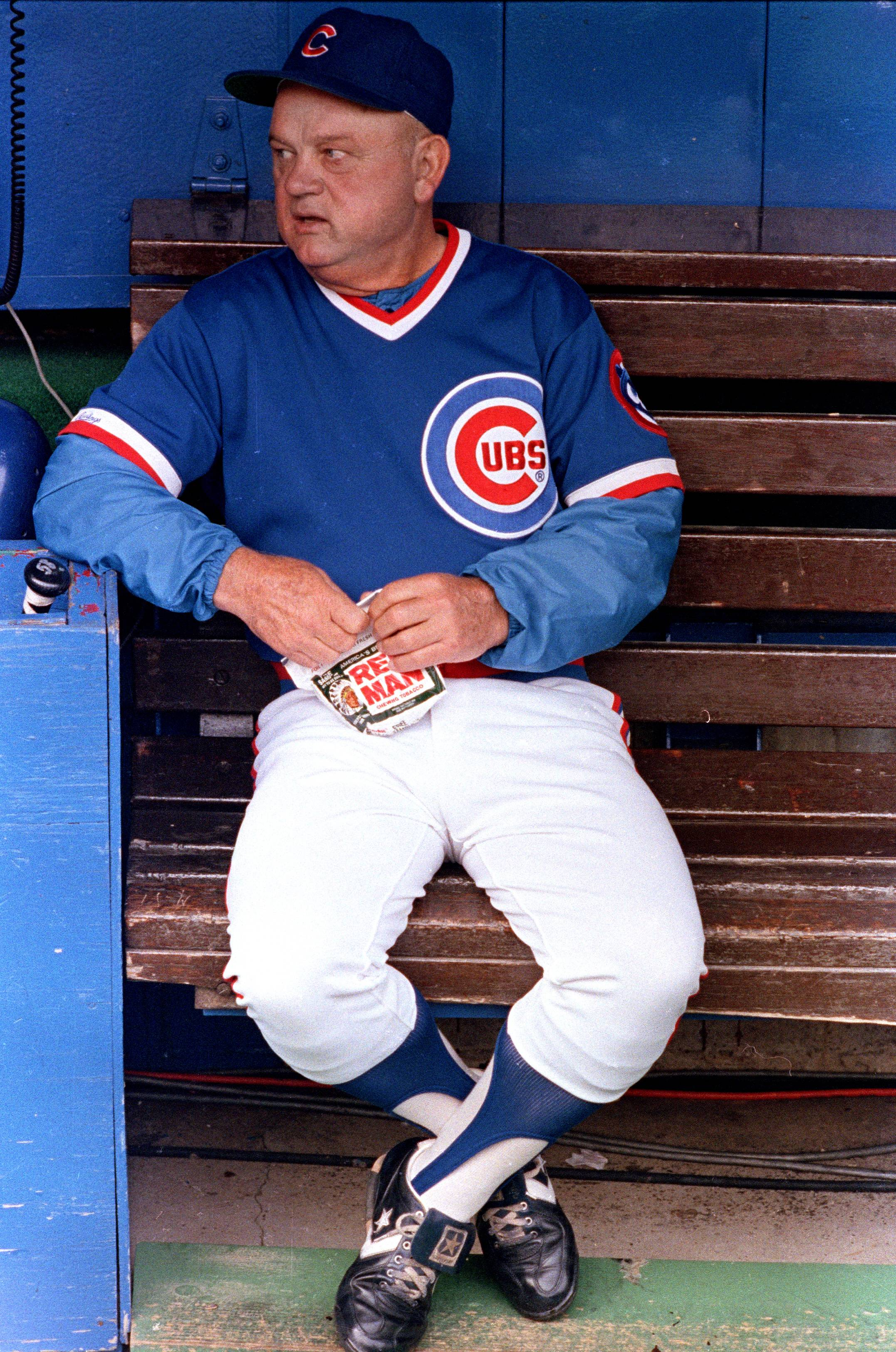 In this Sept. 30, 1989 file photo, Cubs manager Don Zimmer sits in the dugout before a game against the Cardinals in St. Louis. Zimmer, a popular fixture in professional baseball for 66 years as a manager, player, coach and executive, died Wednesday. He was 83.