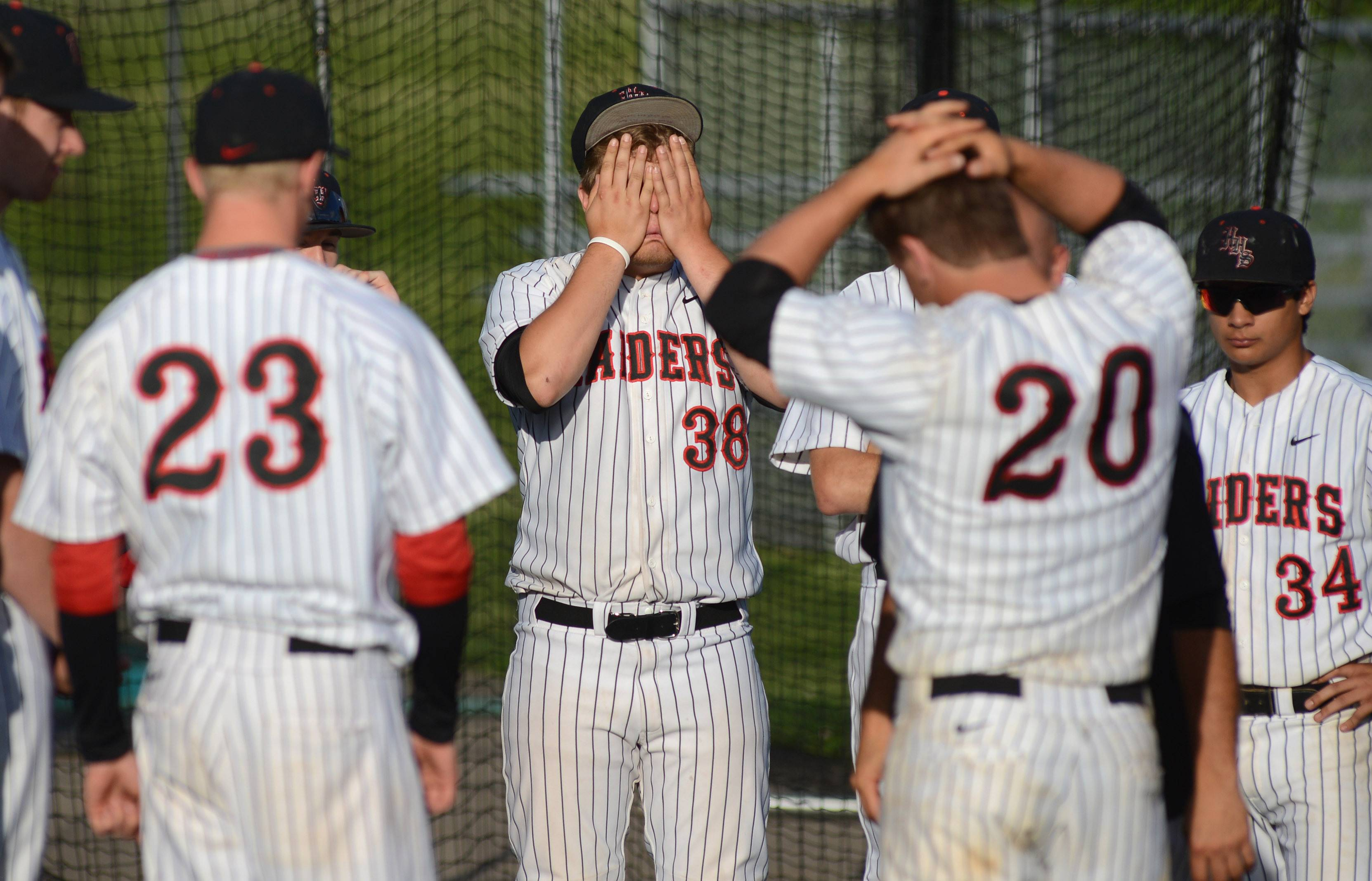 Huntley's Luke Annen (38) and Mark Skonieczny (20) gather their emotions after their loss to Prairie Ridge in the Class 4A McHenry sectional semifinal on Wednesday.