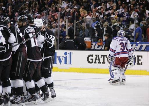Justin Williams scored 4:36 into overtime after a turnover by Dan Girardi, and the Los Angeles Kings beat the New York Rangers 3-2 on Wednesday night in the Stanley Cup finals opener.