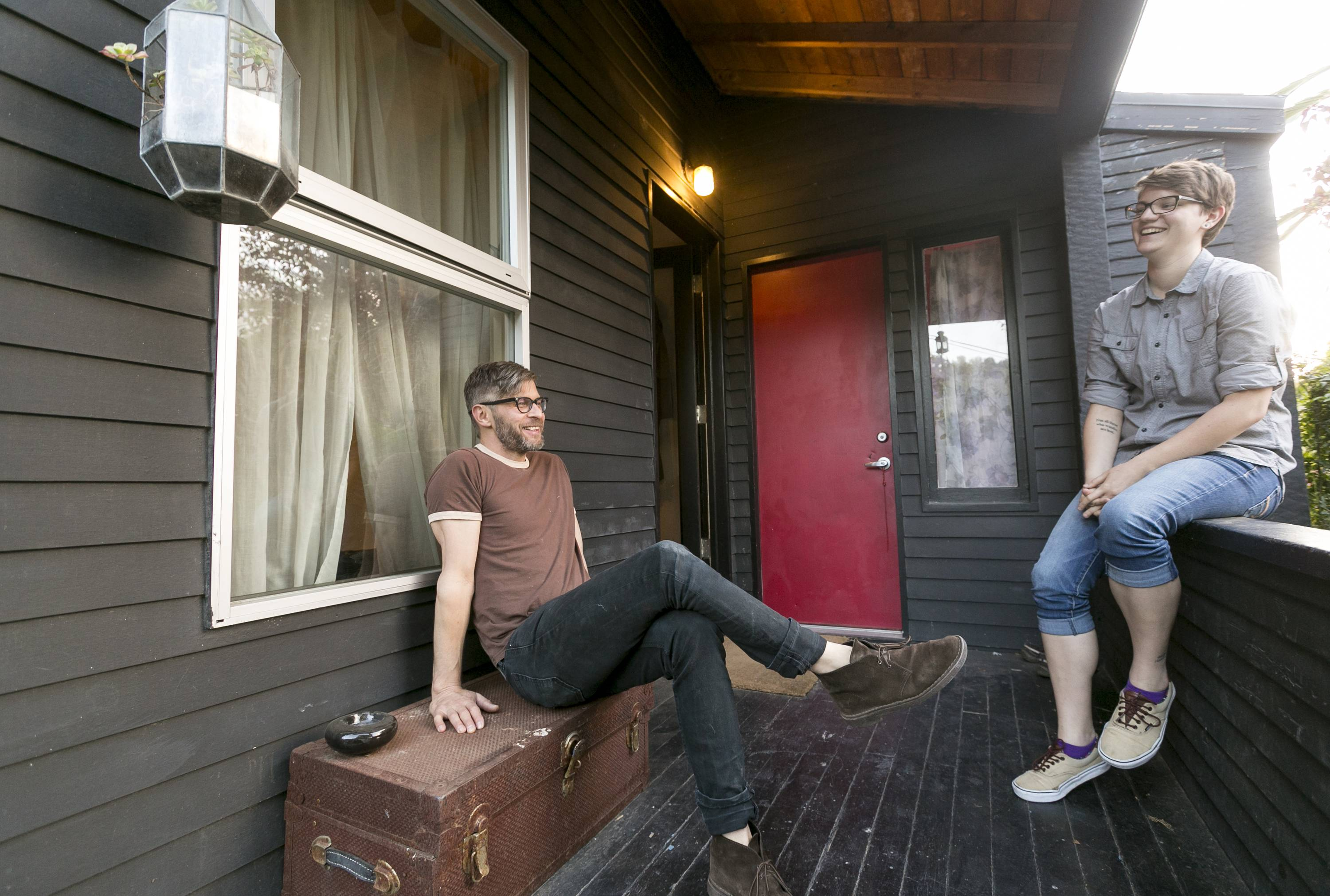 Ceramist and Airbnb host Jonathan Entler, left, and his Airbnb guest Megan Walsh, a Chicago writer on a Summer internship, enjoy the afternoon in his Echo Park home in Los Angeles. Deeper savings can be had through sites such as Airbnb that arrange for people to rent out rooms, apartments or even couches.