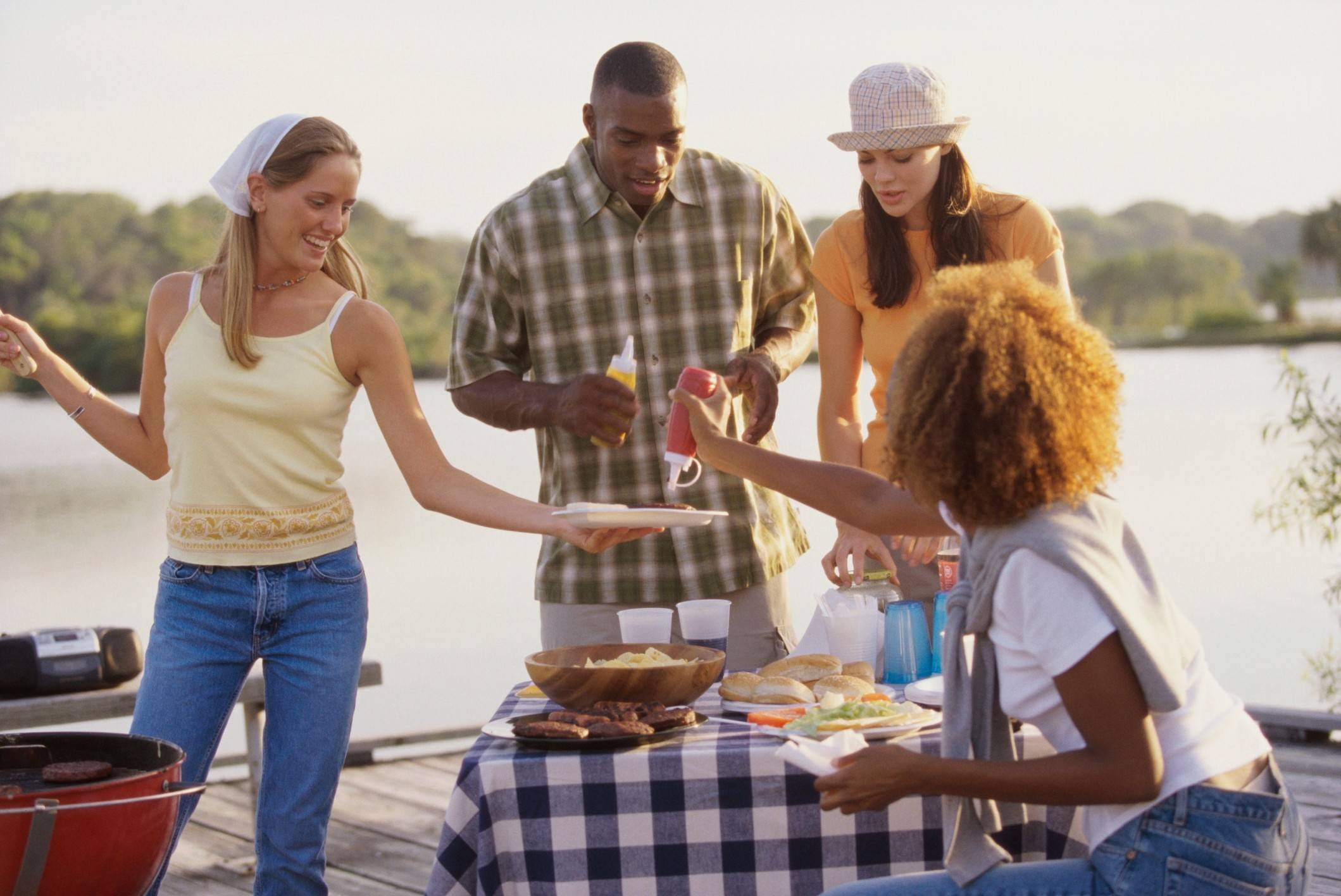 When cooking and eating meals outside this summer, be sure to put food back into refrigeration after one to two hours.