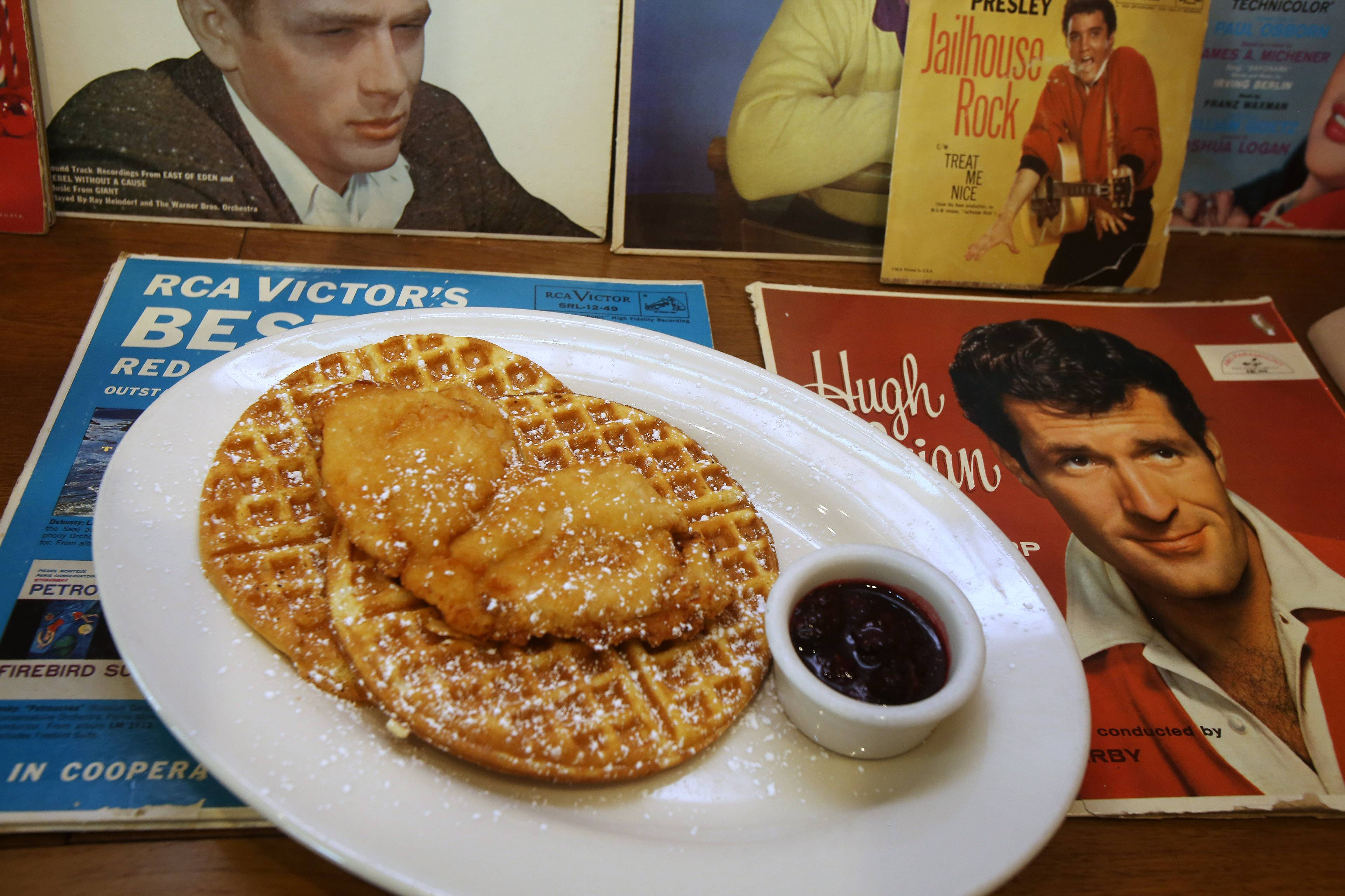 Chicken and Waffles come with blackberry compote and bourbon-spiked maple syrup at Circa 57 in Arlington Heights.