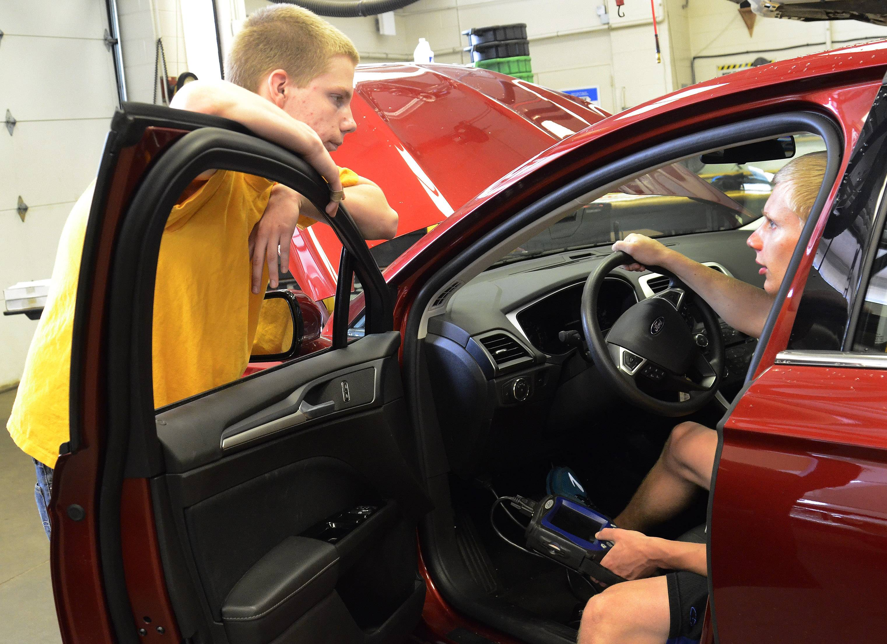 Frank Kranz, left, and Tom Mayer will compete next week for the national championship in the Ford/AAA Student Auto Skills competition. The recent Fremd High School graduates will compete against 49 other teams from across the country in a competition that will challenge them to repair an intentionally bugged car in 90 minutes or less.