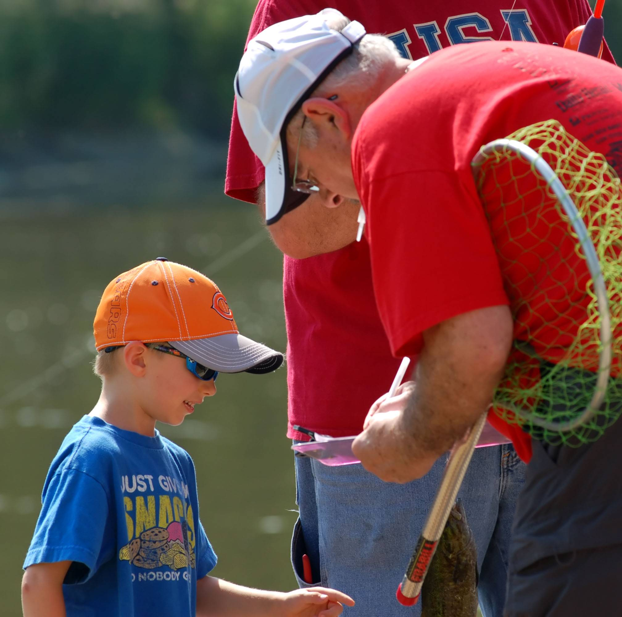 Caleb Williams, 5, of Elgin, caught a 7-ounce, 10-inch smallmouth bass at a previous Fish for Fun event in Elgin. Caleb was with his father, Justin Williams.