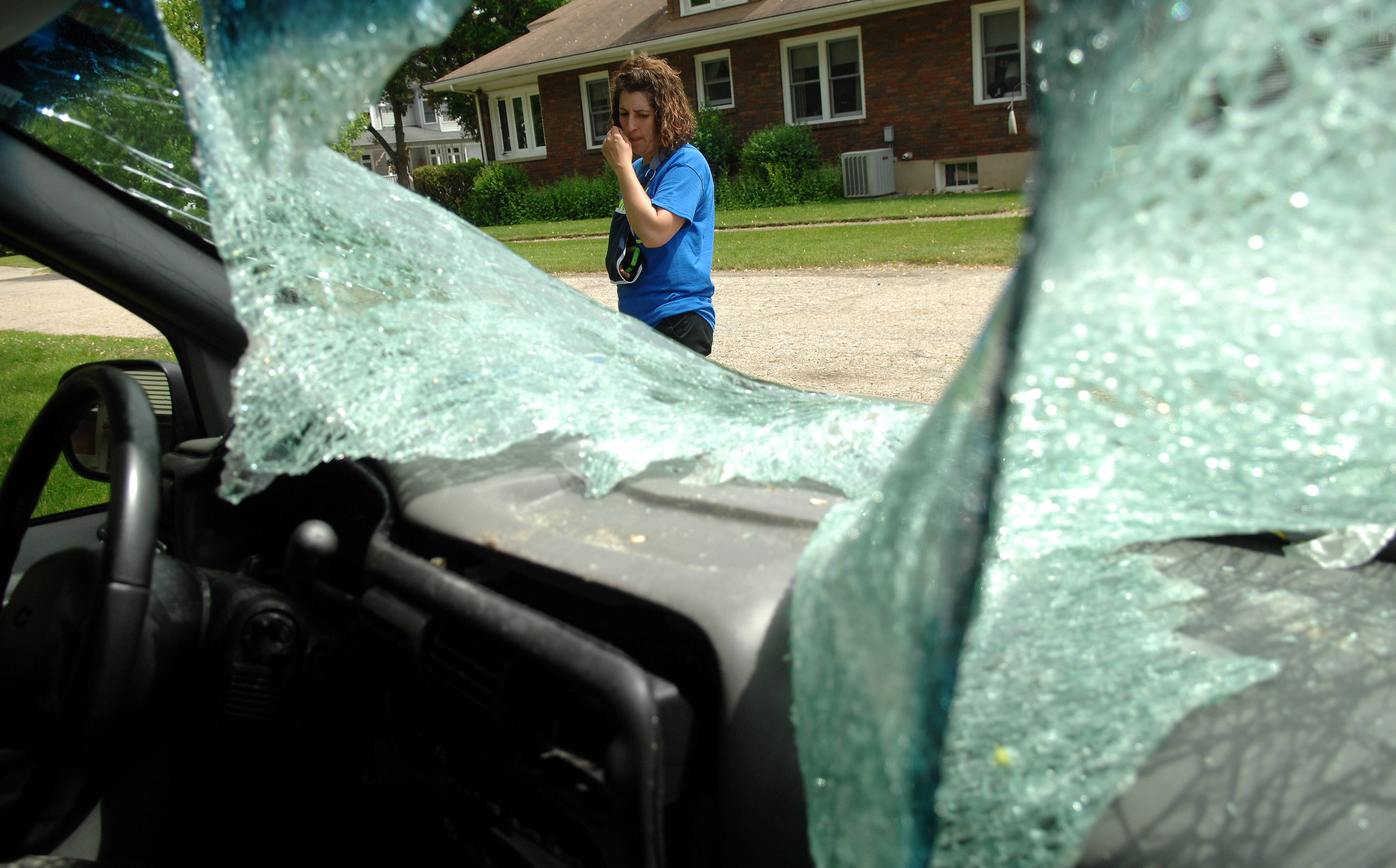 Heidi Conner outside the minivan that was destroyed when a doe crashed through the windshield.