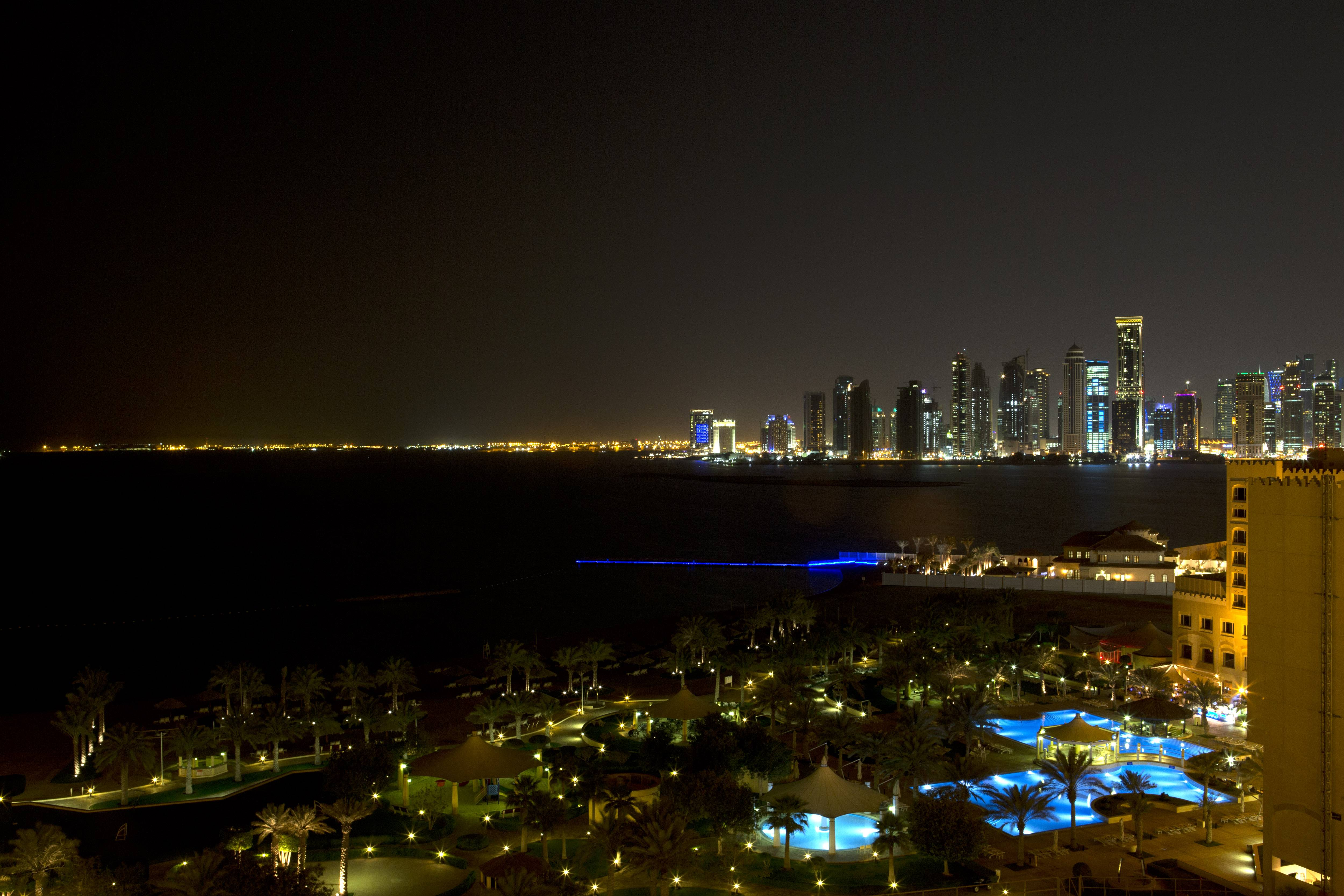 The skyline of Doha, Qatar is seen at night from the St. Regis Hotel. Qatar's behind-the-scenes role in securing the release of U.S. Army Sgt. Bowe Bergdahl June 1, 2014, in exchange for five Taliban operatives was a classic move by a tiny but natural gas-rich Gulf state with outsize ambitions.