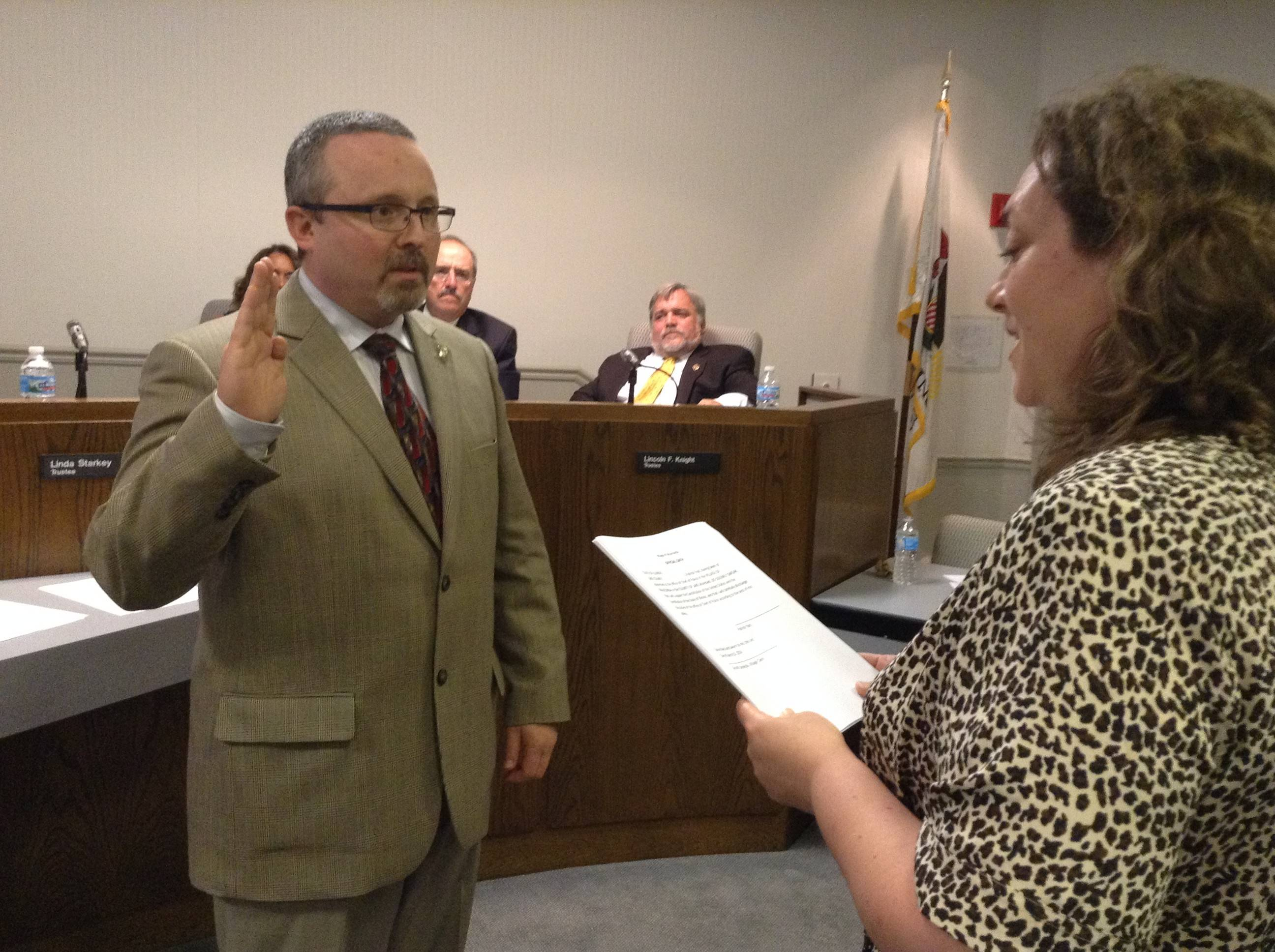 Wauconda Police Chief Patrick Yost recites the oath of office Tuesday evening with help from Clerk Gina Strelecki.