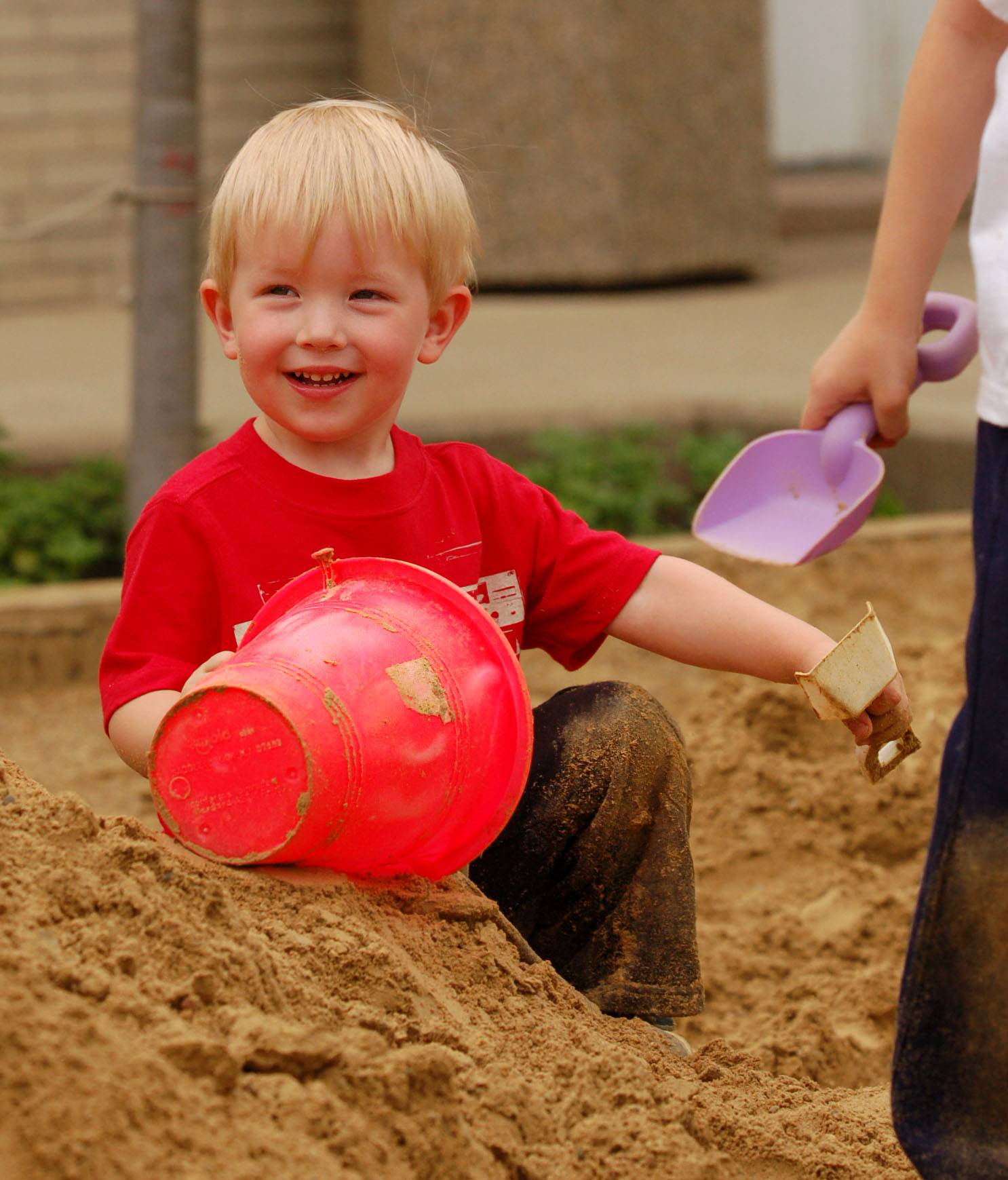 Rowan Sather, 2, of St. Charles plays at the beach at St. Charles RiverFest.