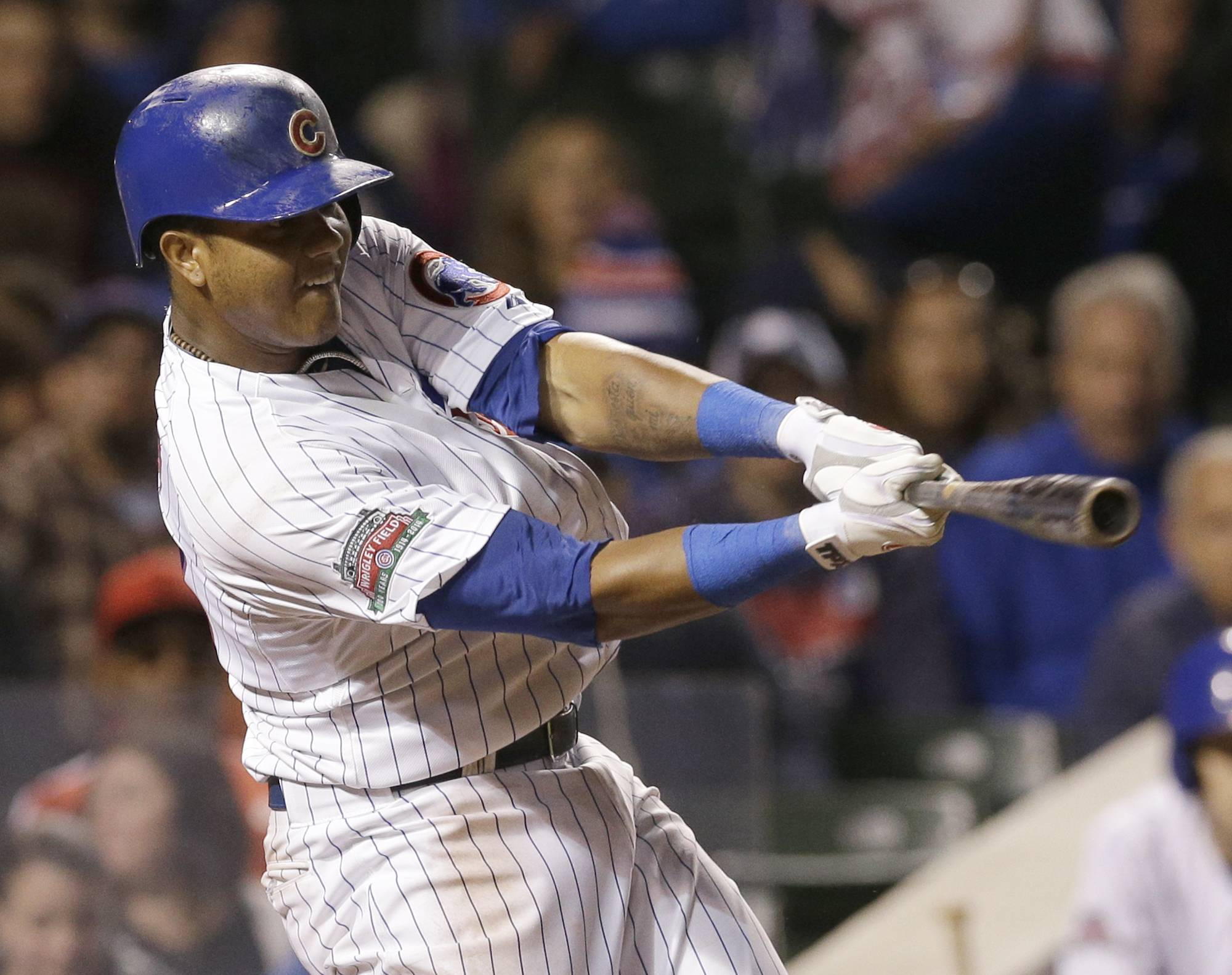 Chicago Cubs' Starlin Castro hits two-run single during the fifth inning of a baseball game against the New York Mets in Chicago, Wednesday, June 4, 2014.