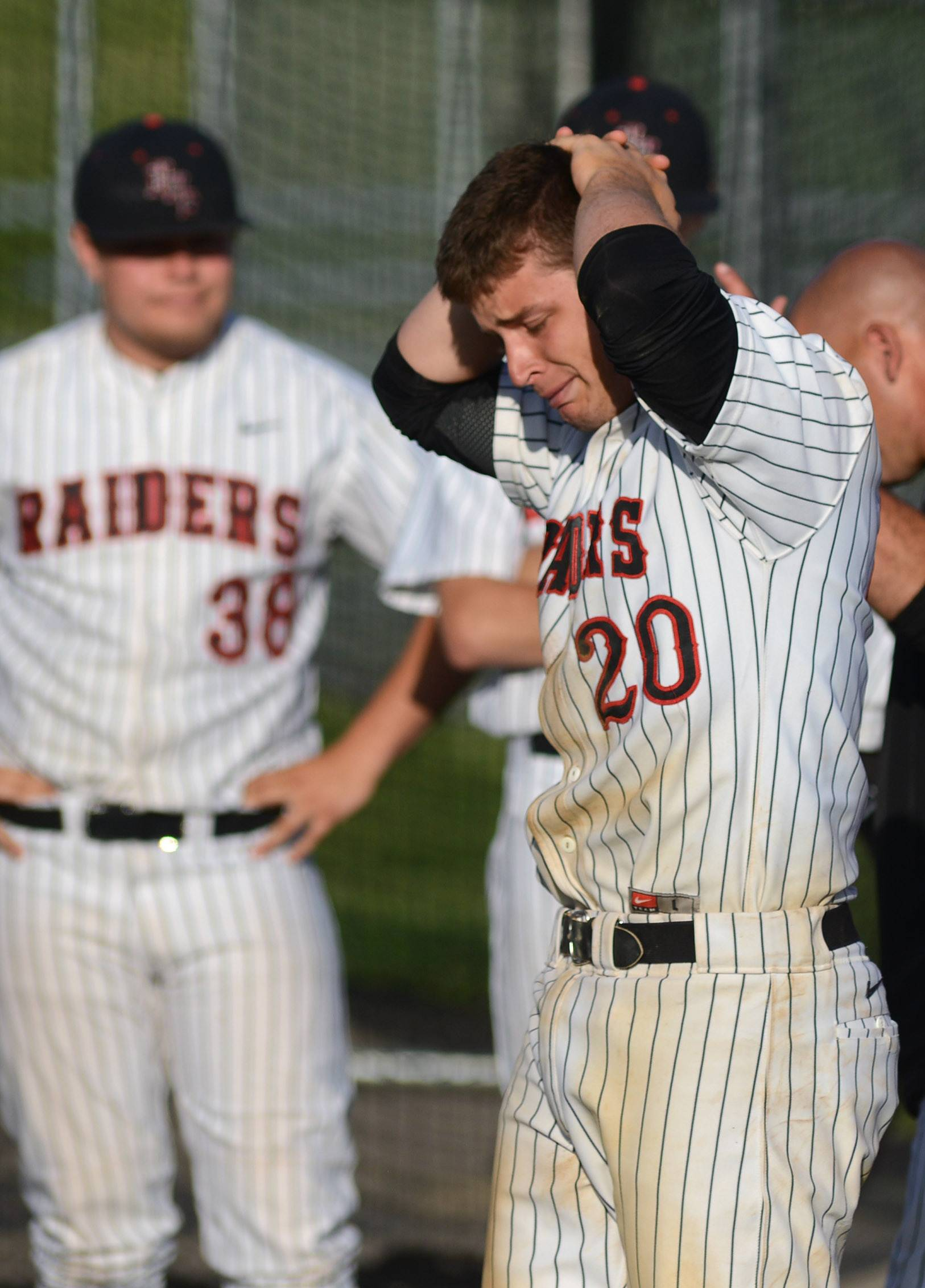 Huntley's Mark Skonieczny (20) gathers his emotions after their loss to Prairie Ridge in the Class 4A McHenry sectional semifinal on Wednesday, June 4.