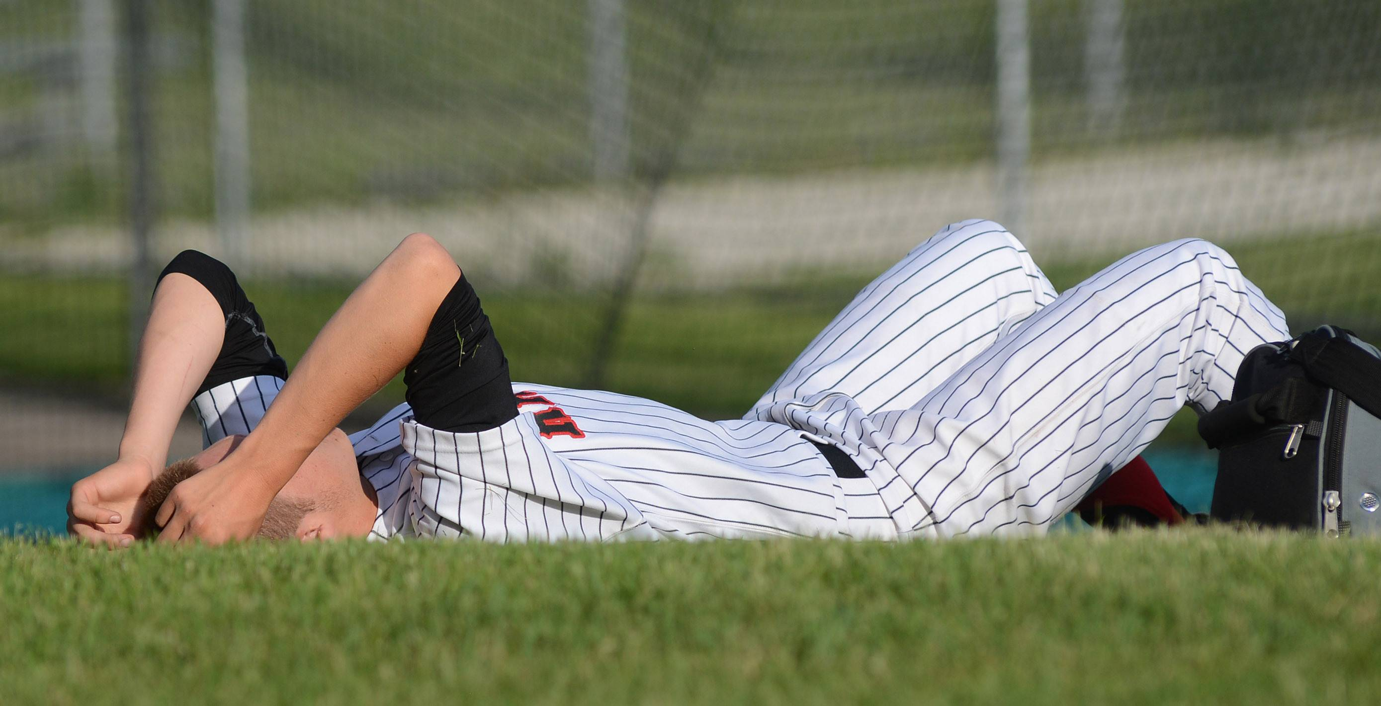 Huntley's Mason Martin sits by himself and gathers his emotions after their loss to Prairie Ridge in the Class 4A McHenry sectional semifinal on Wednesday, June 4.
