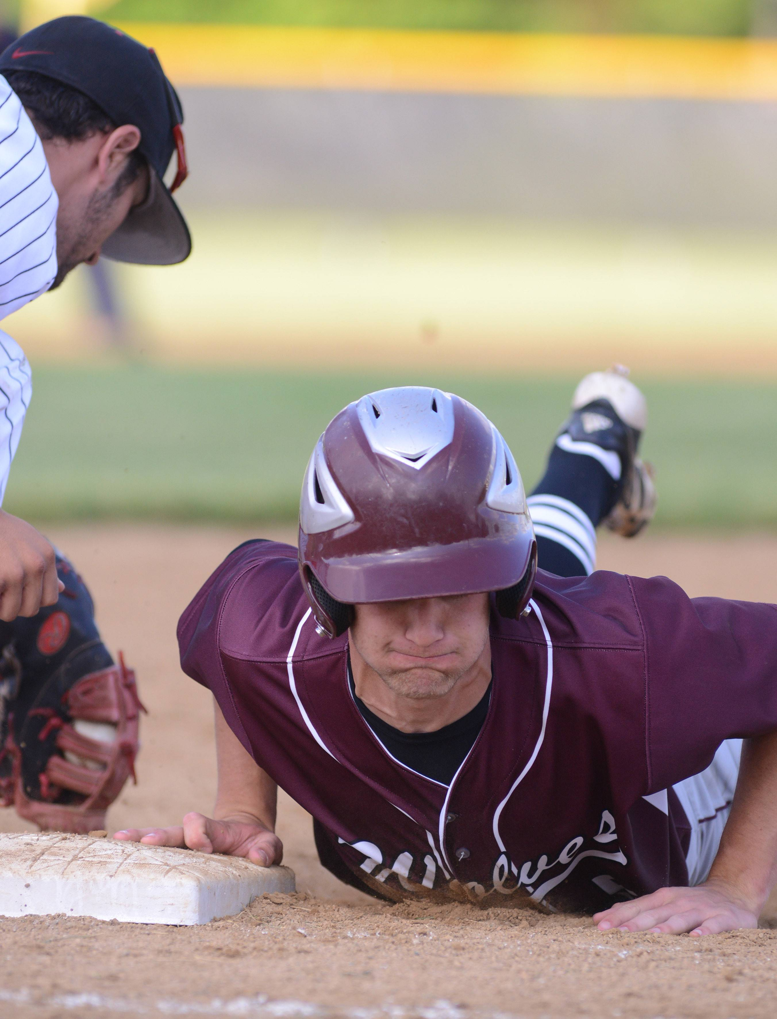 Prairie Ridge's Christopher Slack is safe back on first from Huntley's Anastasios Kiriakopoulos in sixth the inning of the Class 4A McHenry sectional semifinal on Wednesday, June 4.