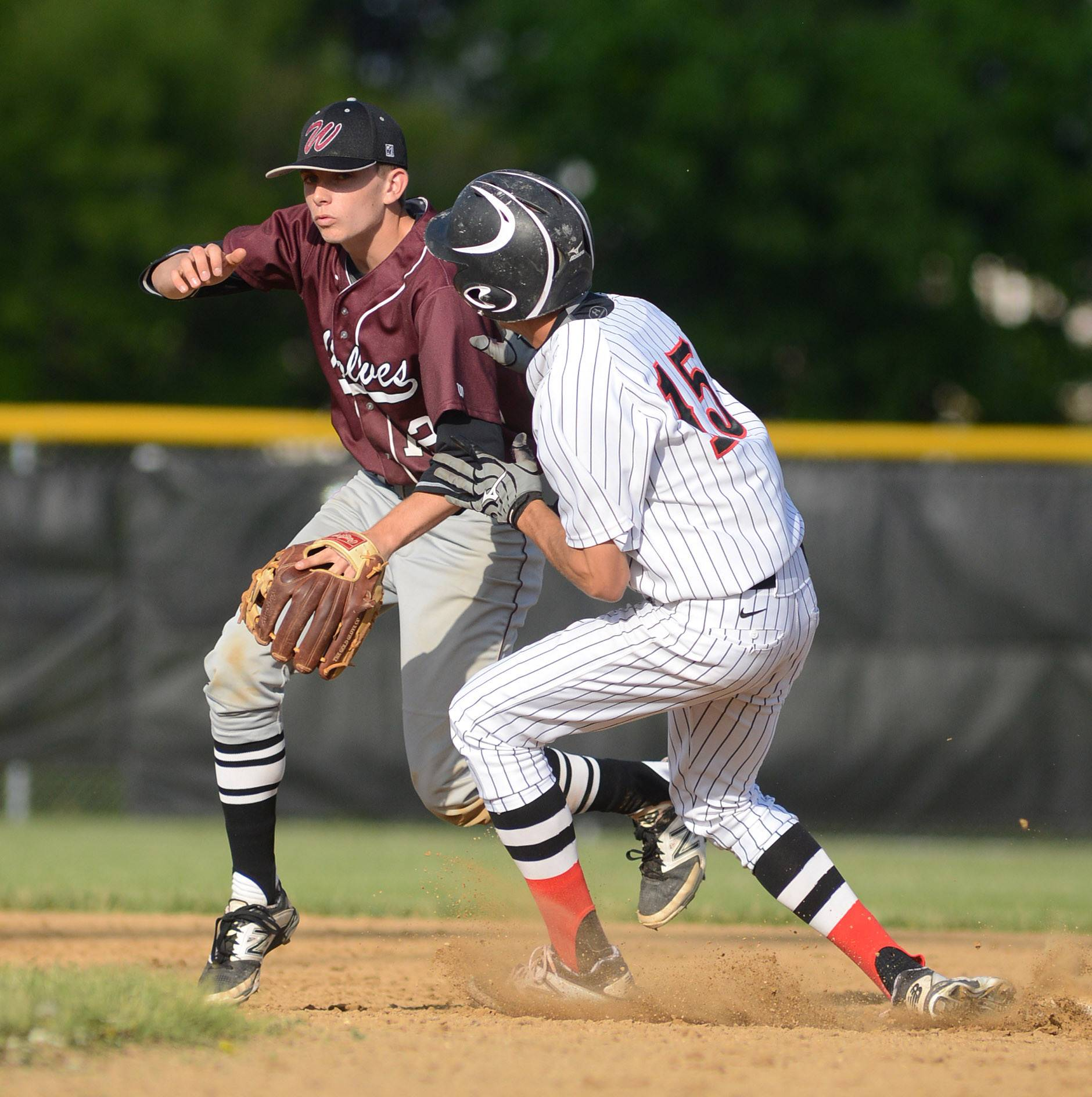 Huntley's Trevor Symbal collides with Prairie Ridge's Connor Schneider at second base in the second inning of the Class 4A McHenry sectional semifinal on Wednesday, June 4.