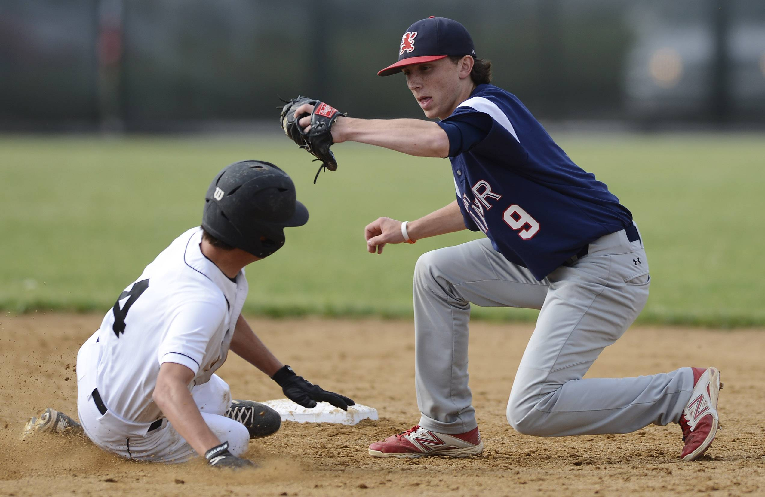 Libertyville's Matt Reed steals second base as St. Viator second baseman Matt Darling tries to grab a throw that bounced into the outfield during Class 4A baseball sectional semifinal play at Glenbrook South on Wednesday. Reed did not advance past second on the play.