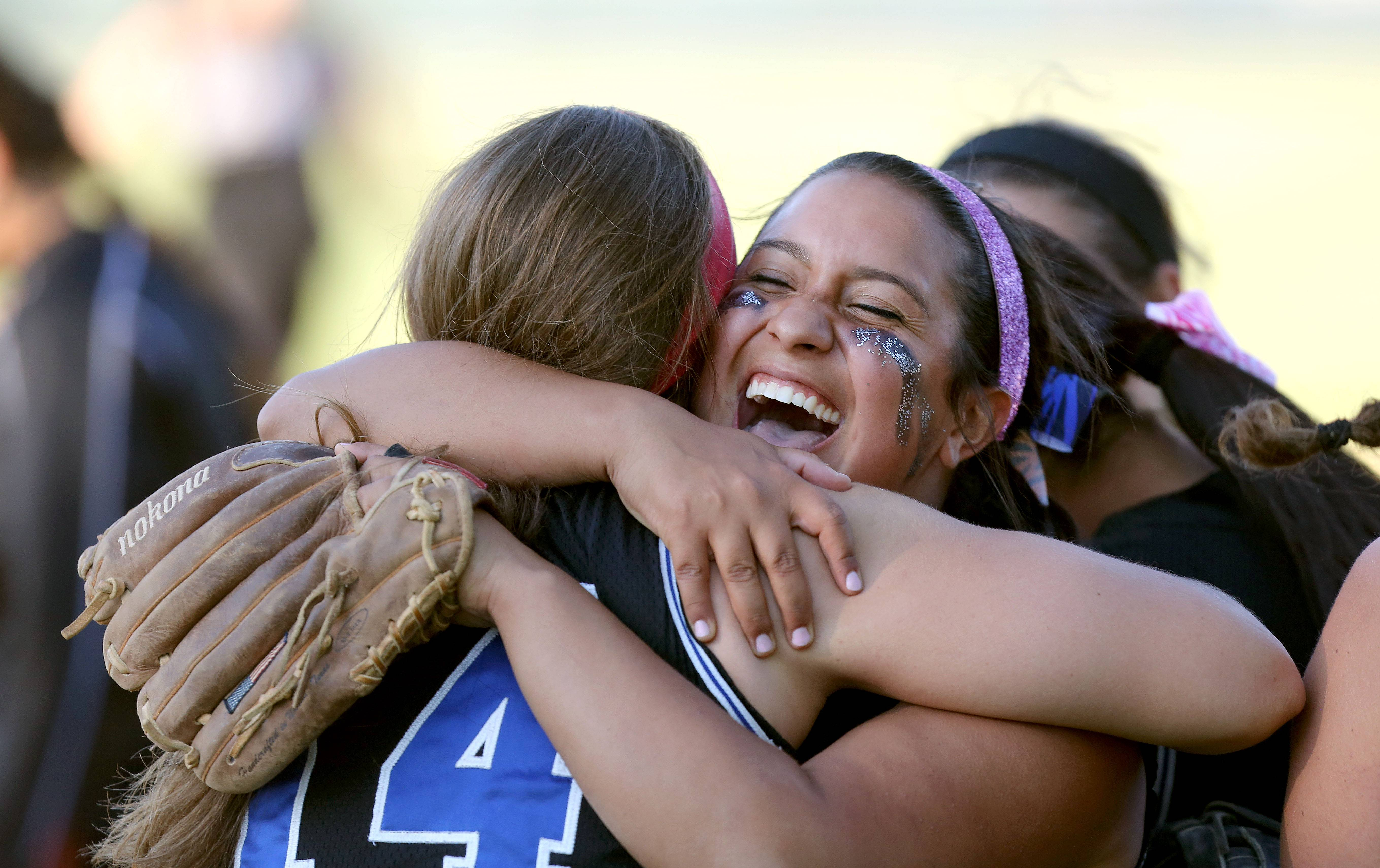 Lake Zurich's Carlee Parsons, right, hugs Maria Schroeder after the Bears topped Libertyville in sectional semifinal play Wednesday at Stevenson.